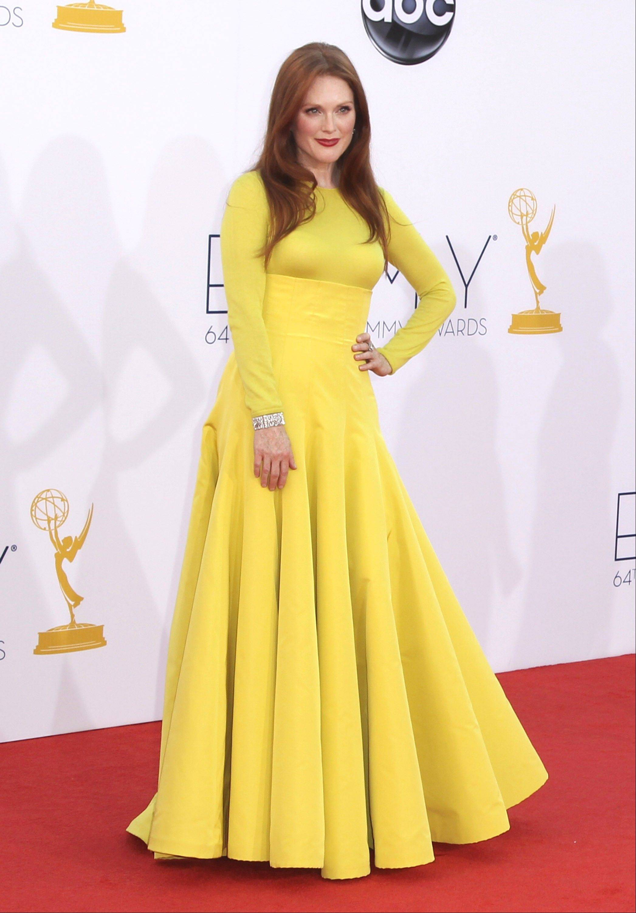 This Sept. 23, 2012 file photo shows actress Julianne Moore at the 64th Primetime Emmy Awards at the Nokia Theatre in Los Angeles. Moore's neon-yellow Dior Haute Couture outfit (really a sweater and ball skirt) spawned a love-it-or-hate-it debate among armchair style critics.
