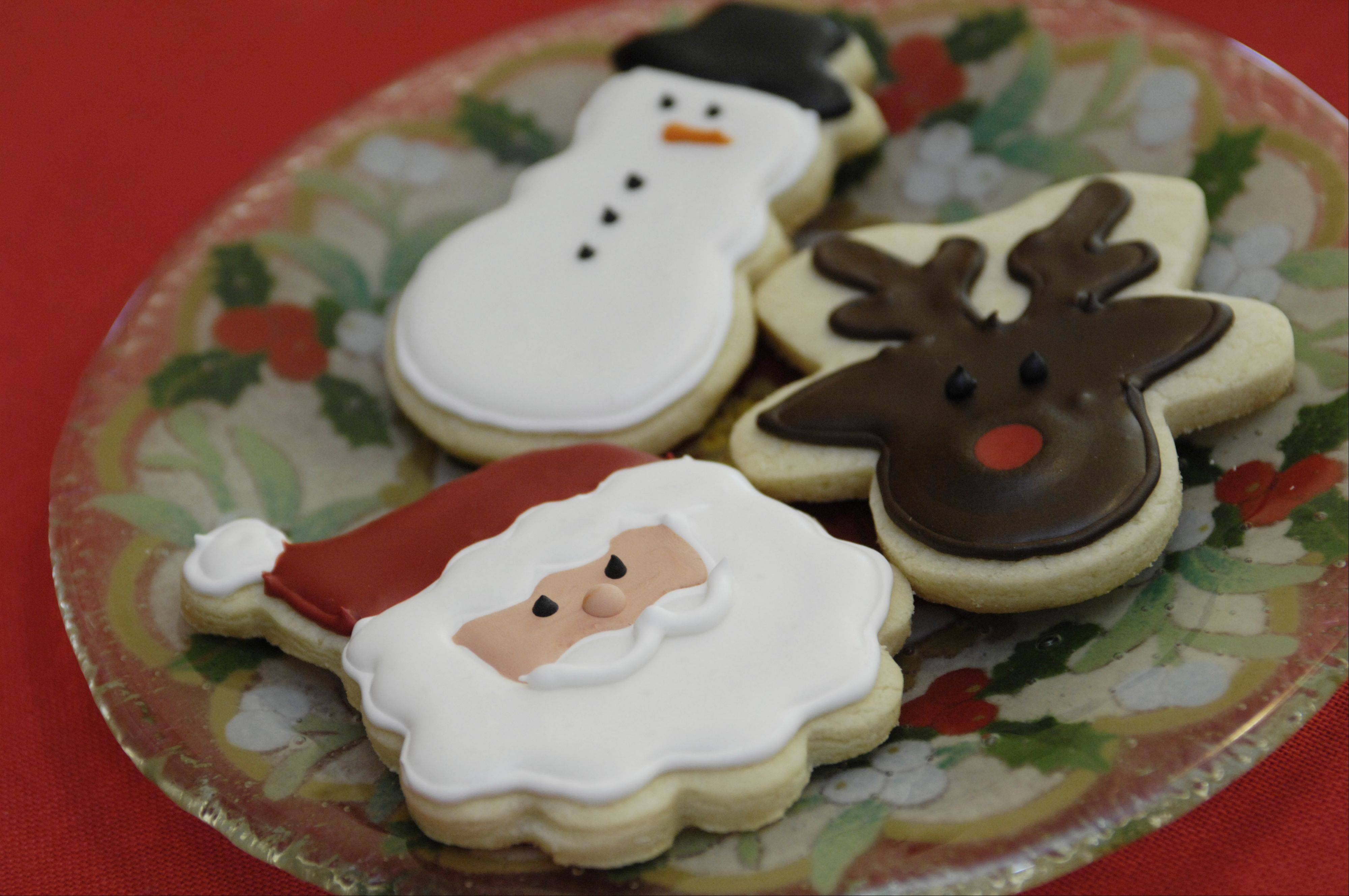 Danae Chatel lovingly decorates holiday cookies.