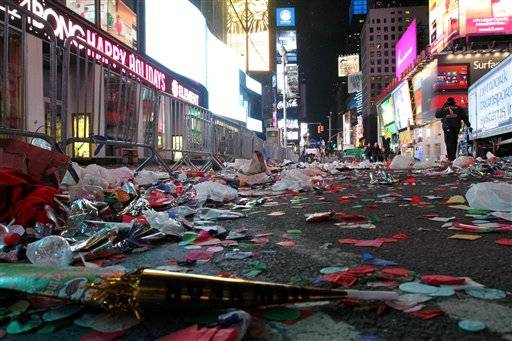 Confetti and other items from the New Year's festivities litters the street in New York's Times Square early Tuesday morning. Fineberg)