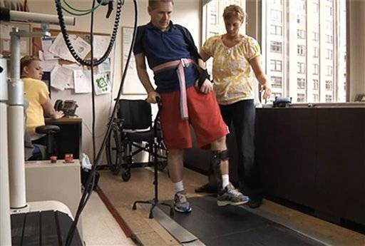 Sen. Mark Kirk. going through a walking exercise at the Rehabilitation Institute of Chicago following a stroke.