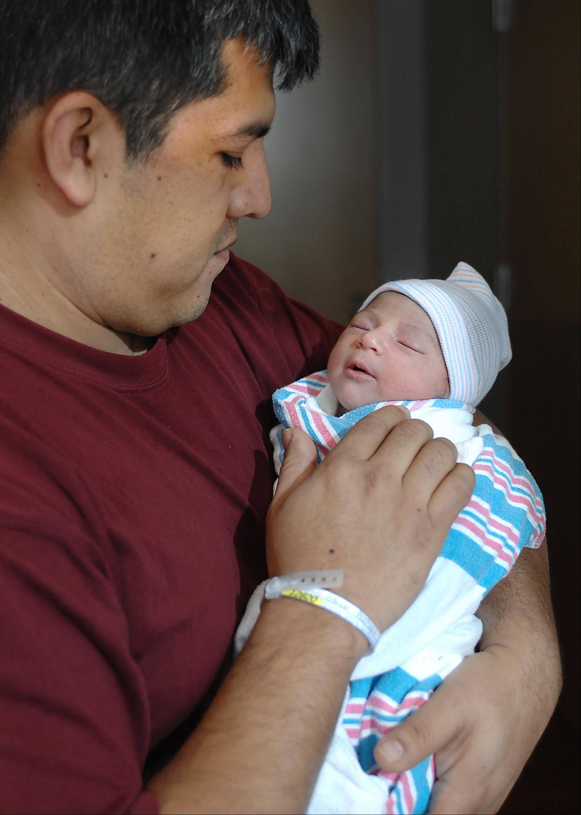 Daniel Hernandez of Algonquin holds his daughter Isabel, the first baby born in Kane County in 2013. She weighed 6 pounds, 1 ounce and was 19 inches long. She was born to Esbeide Gutierrez and her husband, Daniel Hernandez at Sherman Hospital in Elgin at 8:43 Tuesday morning.