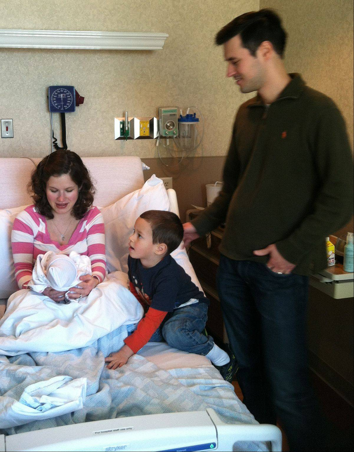 The first baby born in McHenry County in 2013 is Christopher Canache, born to parents Daniela and Pedro Canache of Huntley at 12:10 a.m. at Centegra Hospital in Woodstock. Her 4-year-old brother, Daniel, visited.