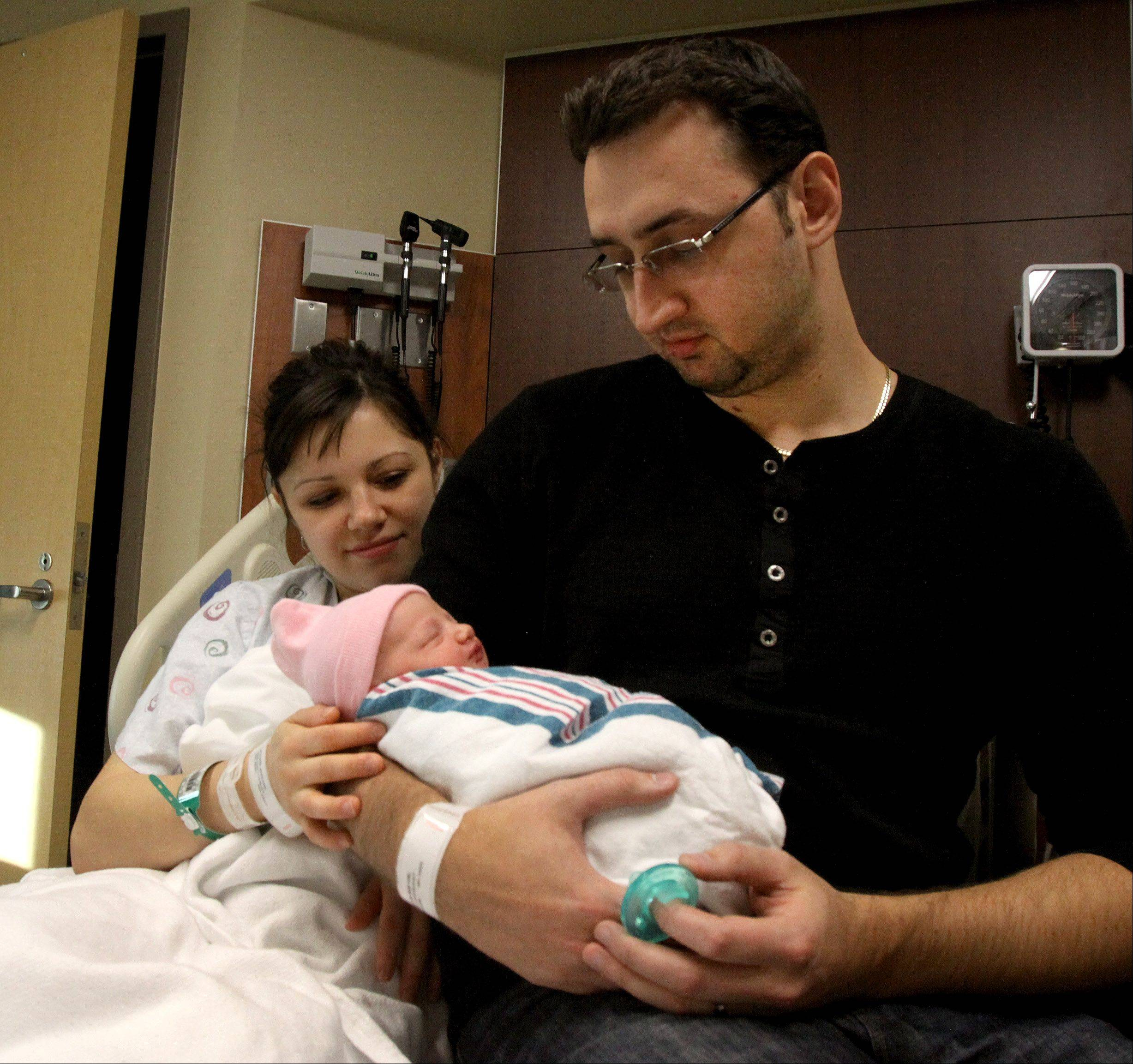 Snezhana and Igor Kalinin of Riverside hold Isabella, who was born at 12:50 a.m. Jan. 1 at Adventist Hinsdale Hospital in Hinsdale. The Kalinins are from Riverside. Isabella has a sister, Ella, who is 3. She was the second baby born in DuPage County on New Year's Day.