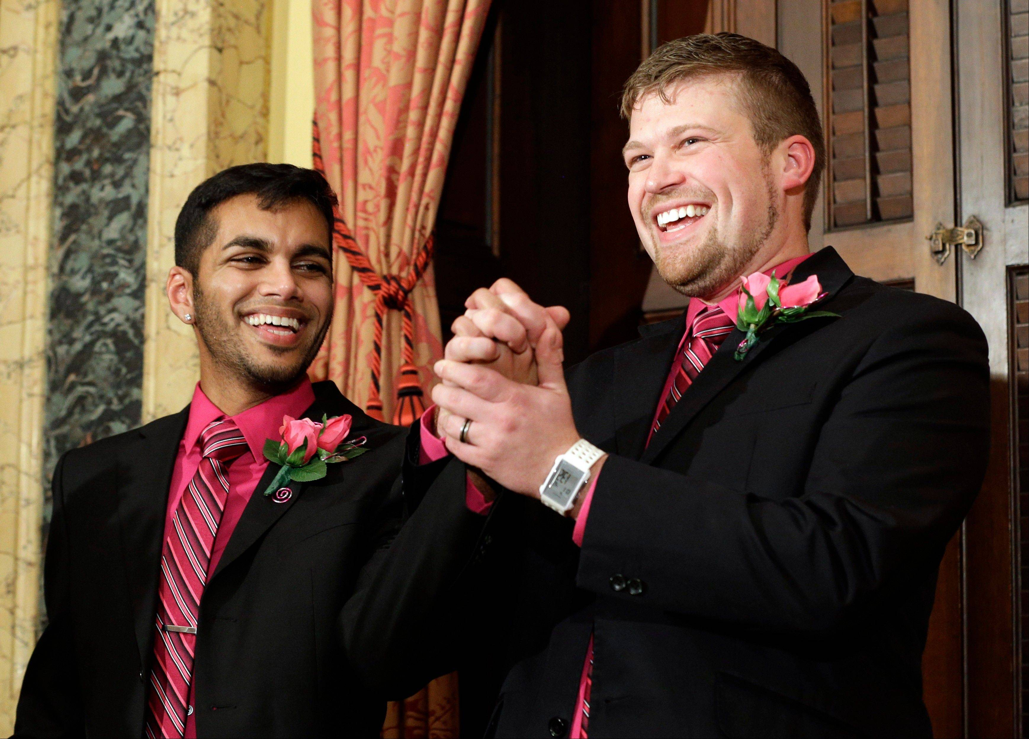 Shehan Welihinda, left, and Ryan Wilson react after participating in a marriage ceremony at City Hall in Baltimore Tuesday.