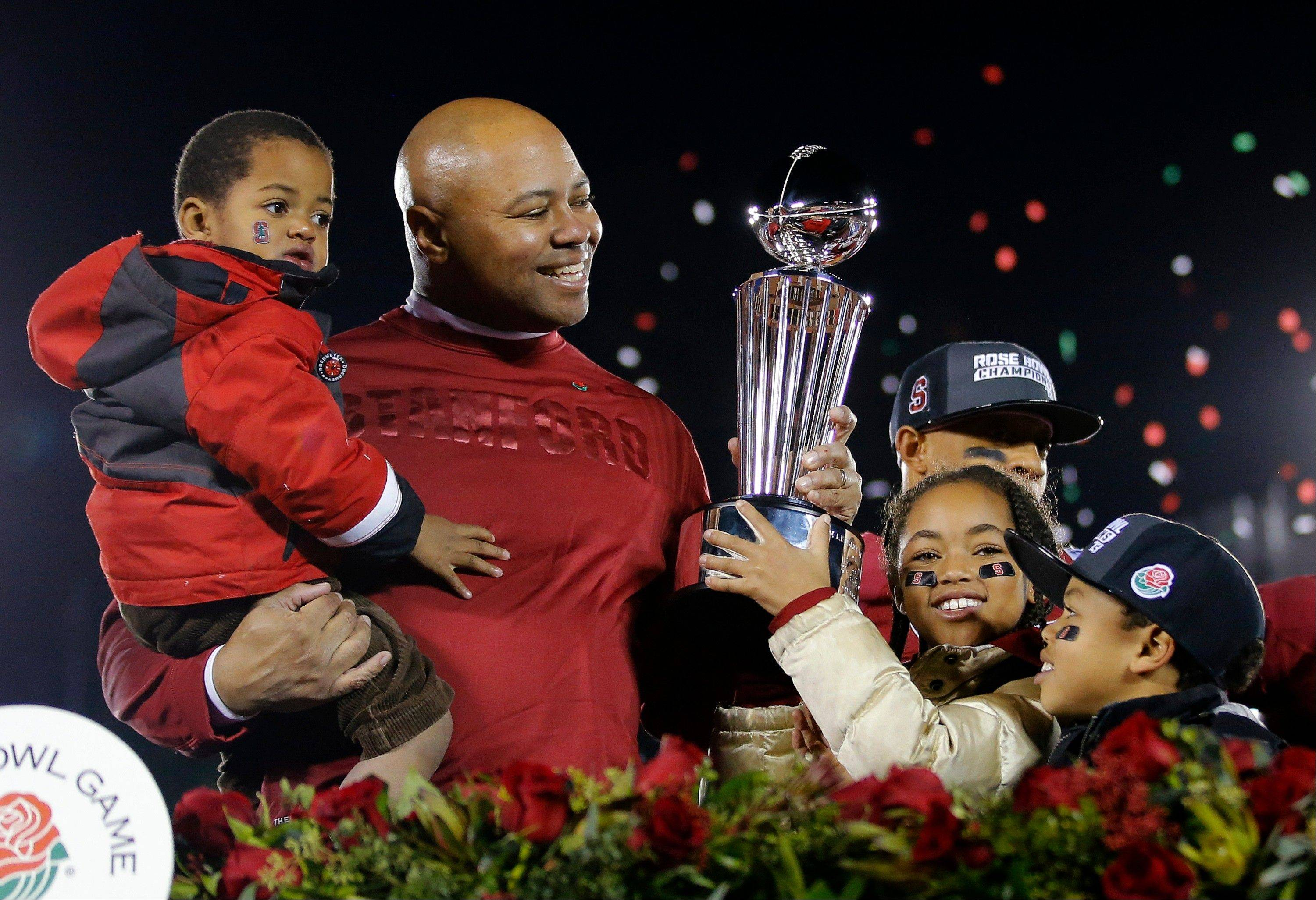 Stanford head coach David Shaw celebrates with his children following their 20-14 win over Wisconsin in the Rose Bowl NCAA college football game, Tuesday, Jan. 1, 2013, in Pasadena, Calif.