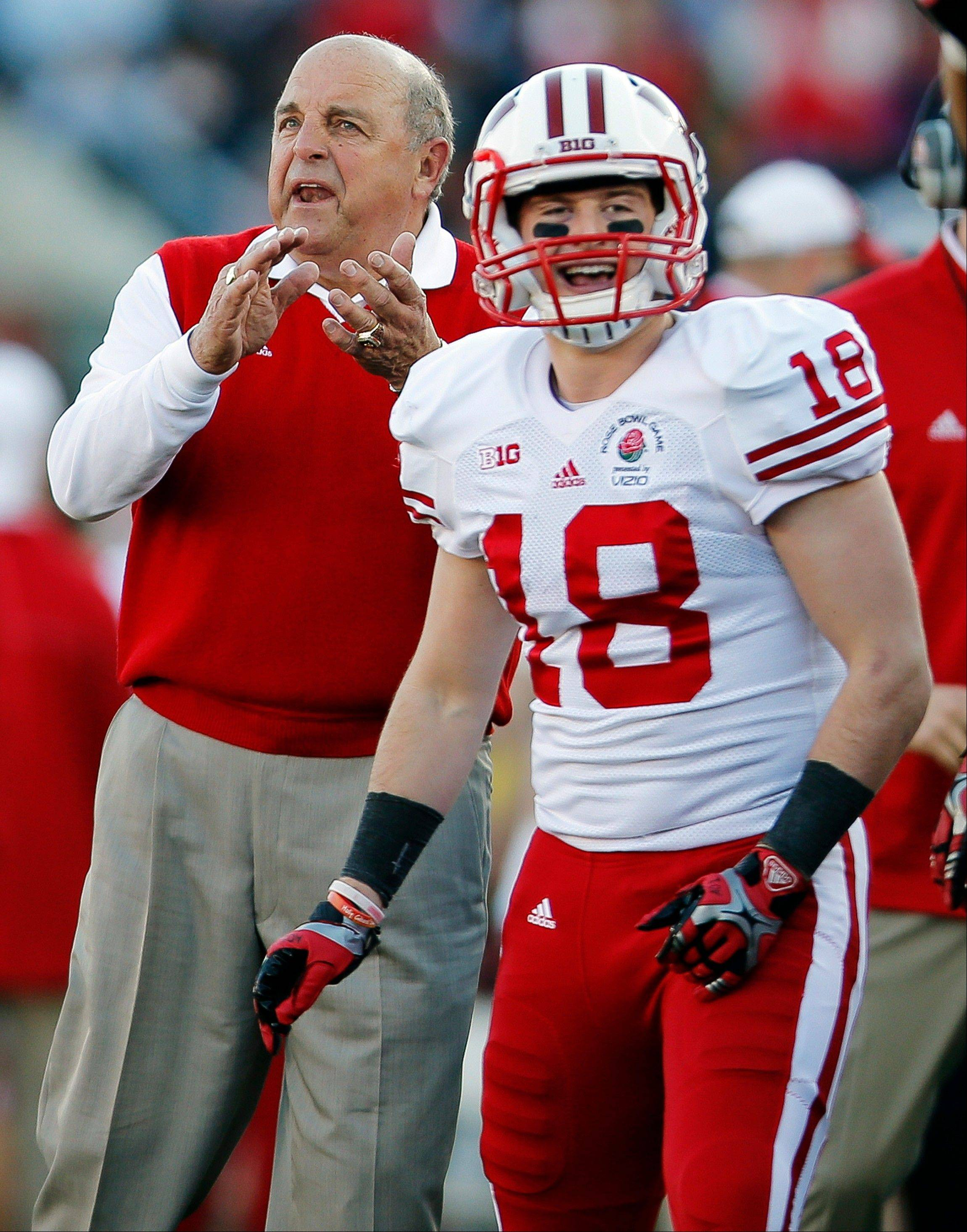 Wisconsin left coach Barry Alvarez, left, and wide receiver Lance Baretz (18) reacts after a touchdown during the first half of the Rose Bowl NCAA college football game against Stanford, Tuesday, Jan. 1, 2013, in Pasadena, Calif.