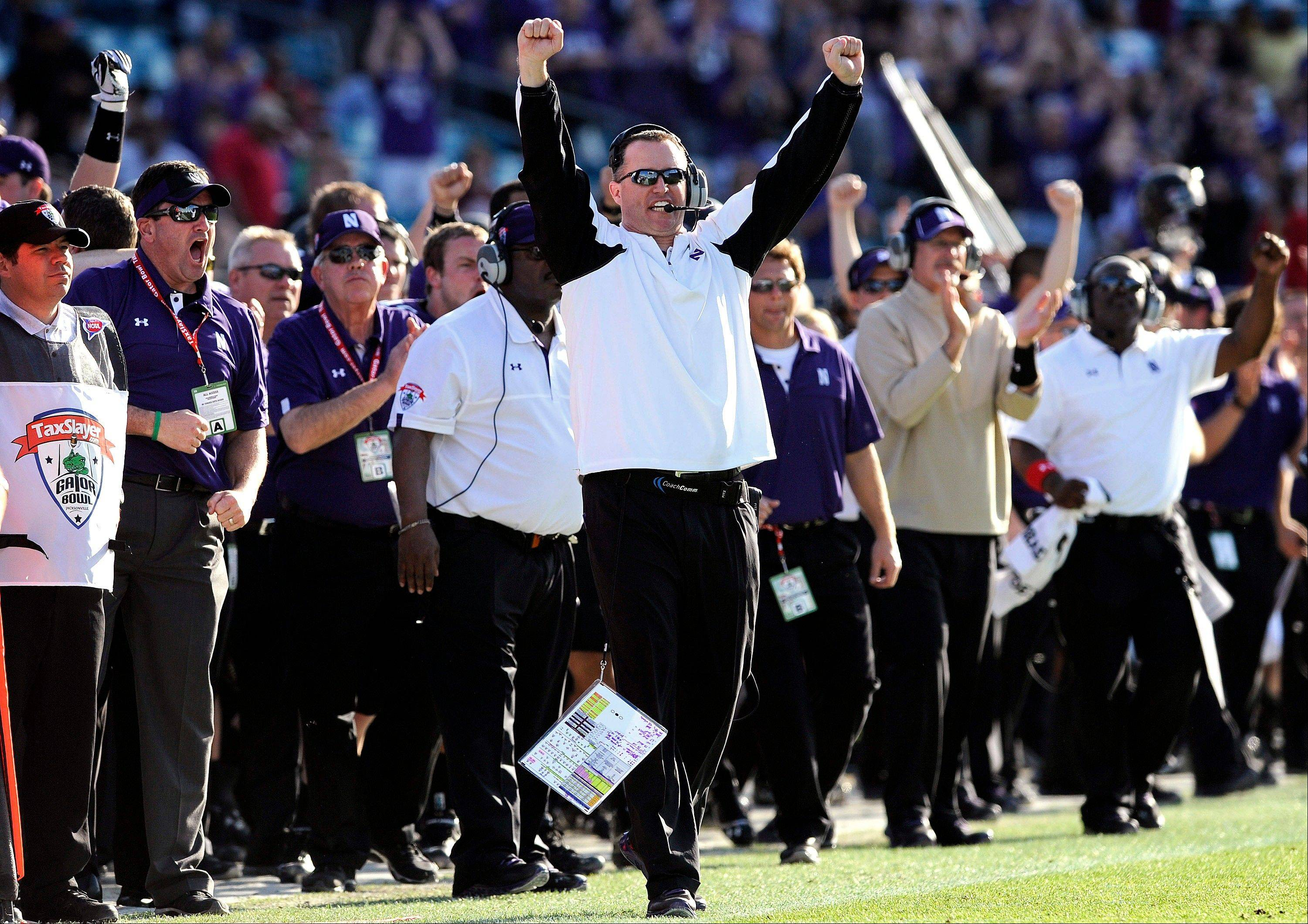 Northwestern head coach Pat Fitzgerald celebrates a first down in the closing seconds of the second half of the Gator Bowl NCAA college football game against Mississippi State, Tuesday, Jan. 1, 2013 in Jacksonville, Fla. Northwestern won 34-20.