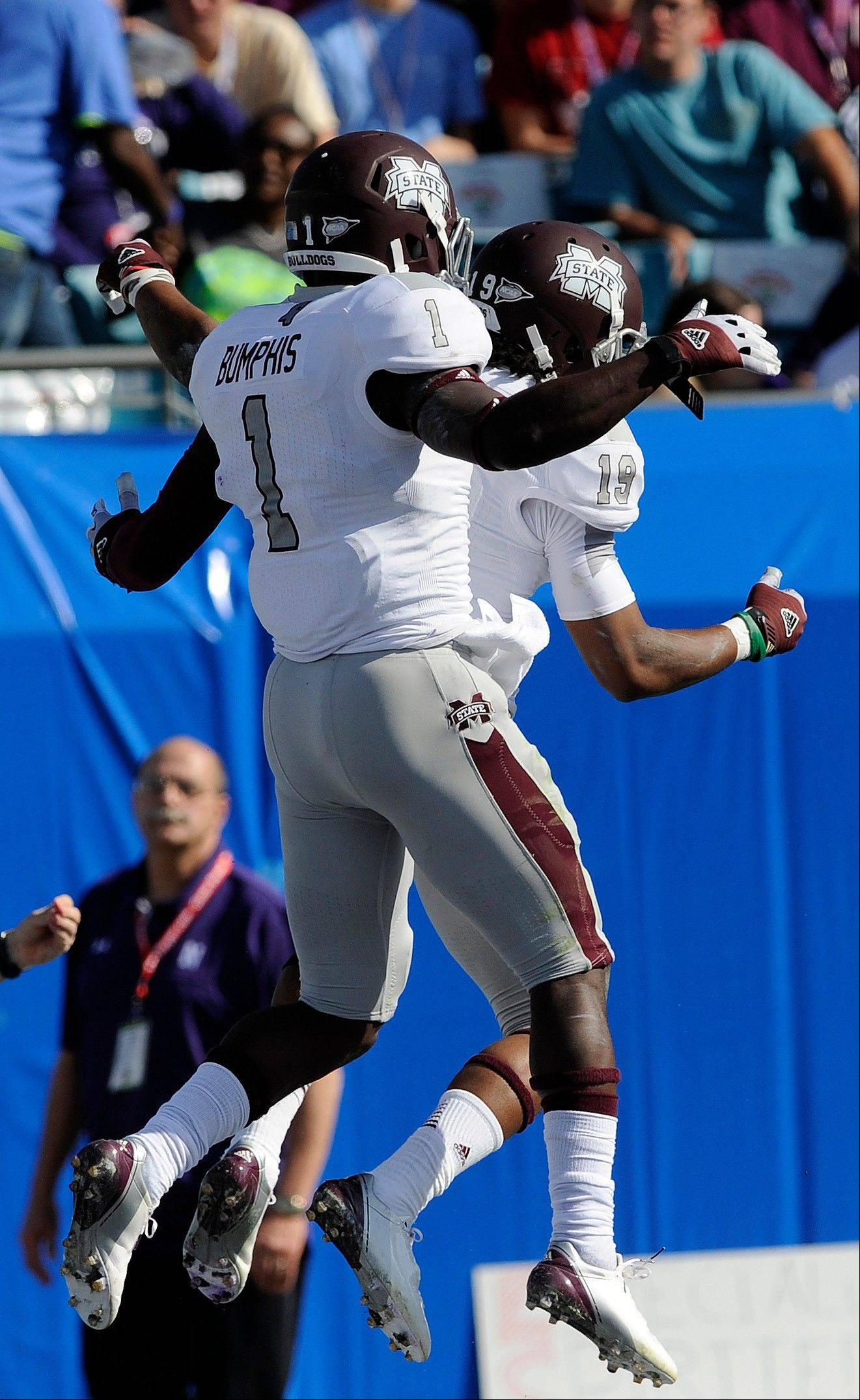 Mississippi State wide receivers Arceto Clark (19) and Chad Bumphis (1) celebrate Clark's touchdown catch against Northwestern during the first half of the Gator Bowl NCAA college football game, Tuesday, Jan. 1, 2013, in Jacksonville, Fla.