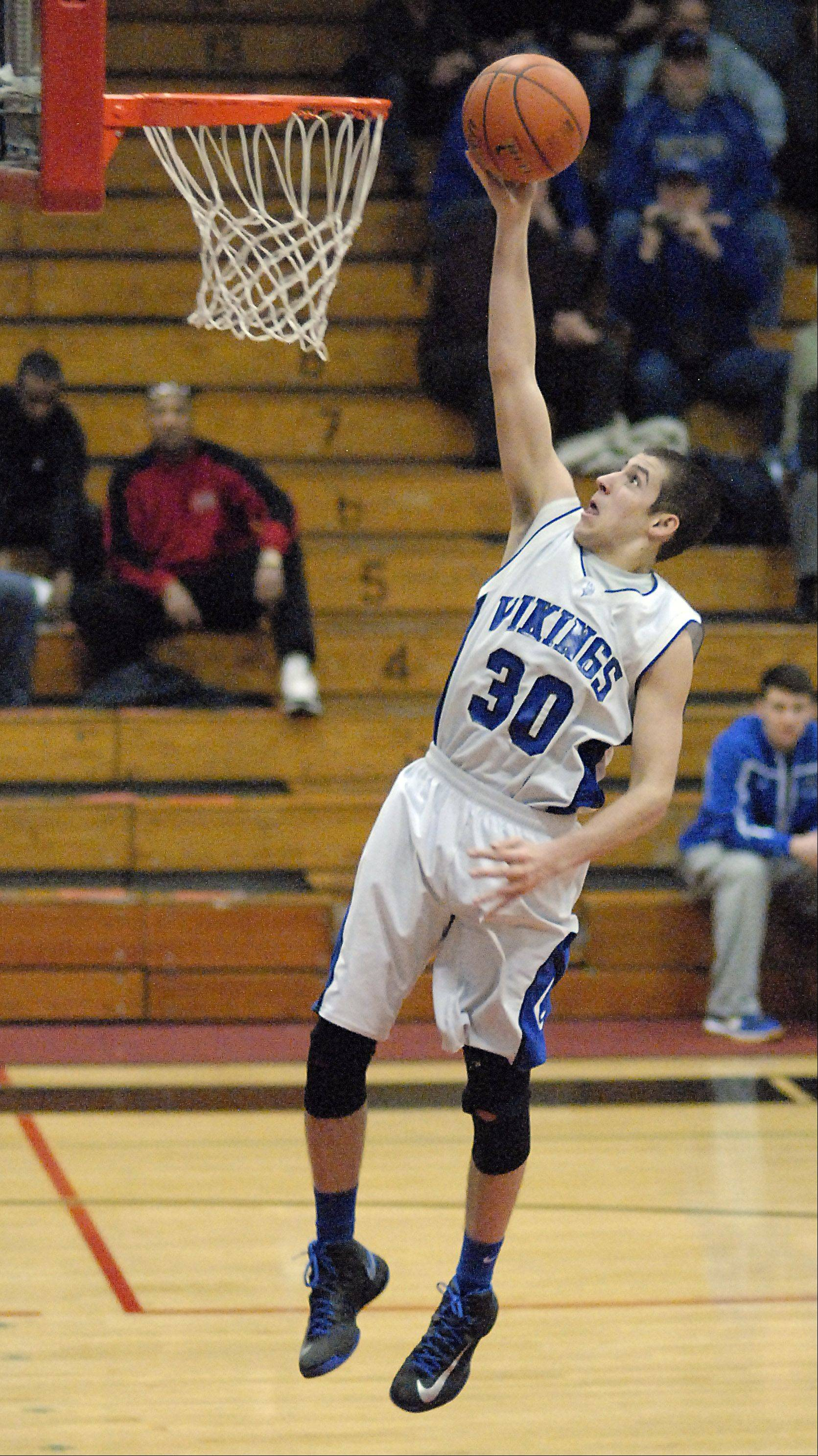 Geneva's Chris Parrilli sinks a shot Friday.