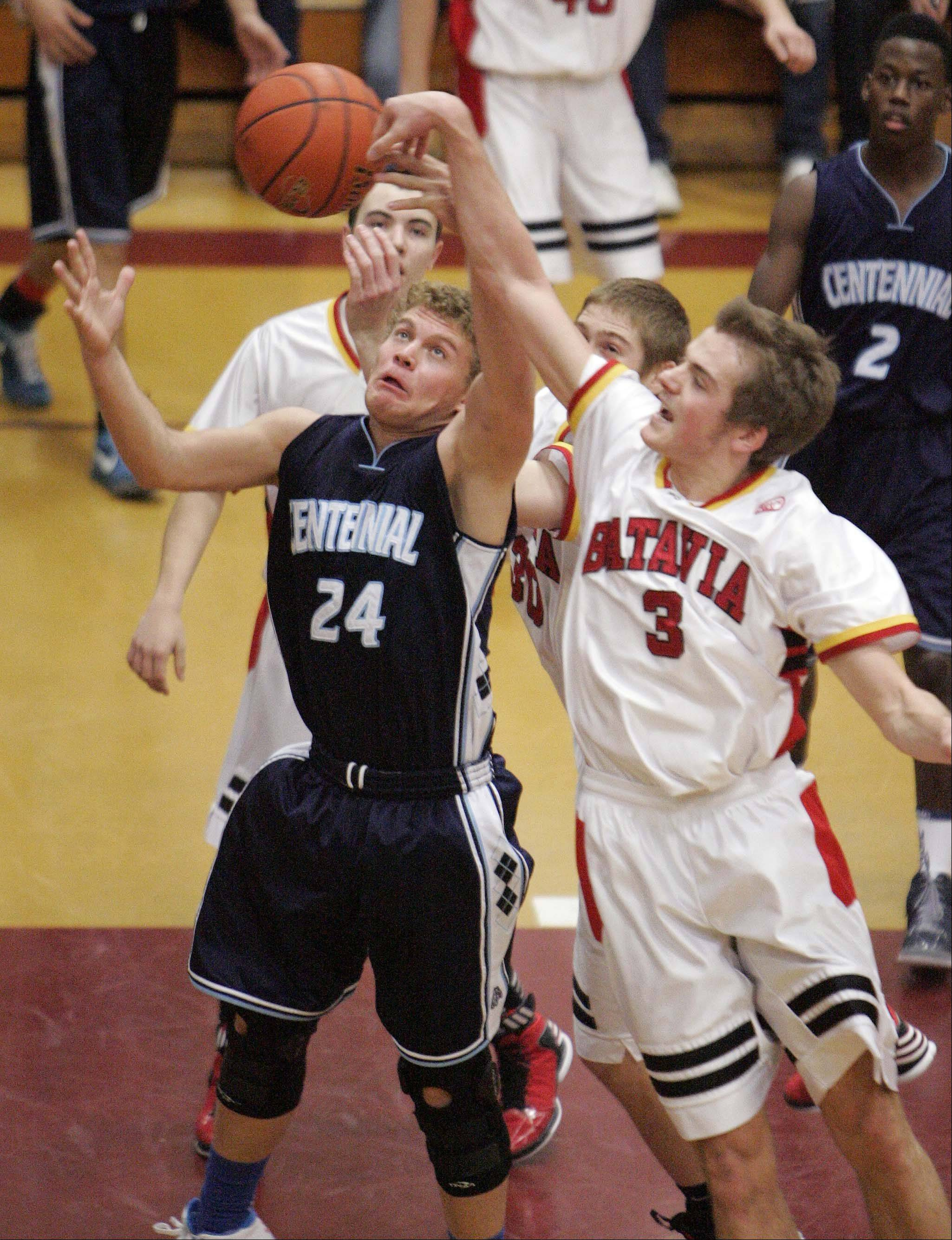 Batavia guard Jake Pollack, 3, knocks a rebound from the hands of Las Vegas Centennial's Austin Turley, 24, during the third place game of the 38th Annual Elgin Boys Holiday Basketball Tournament on Saturday in Elgin.