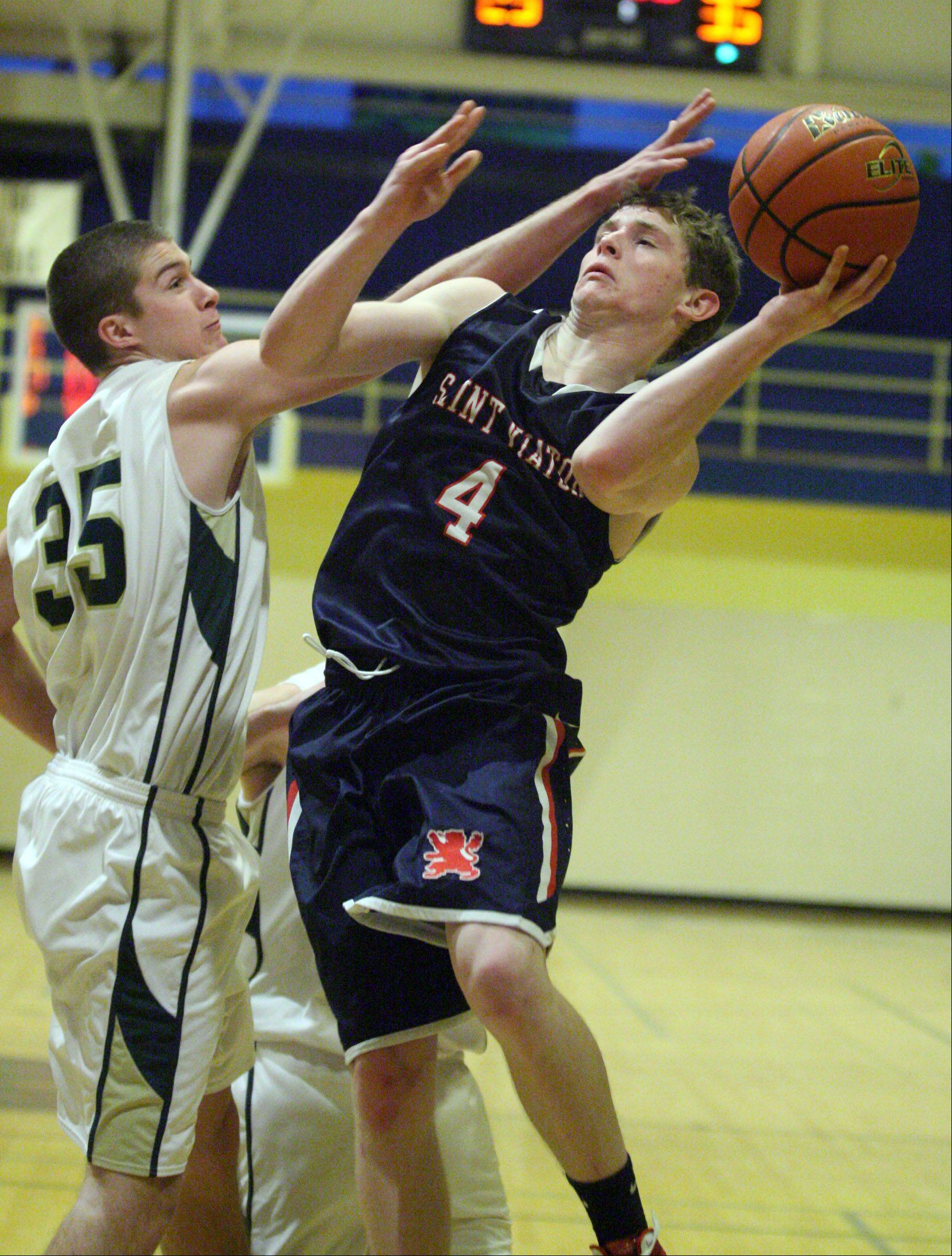 St. Viator's Kevin Hammarlund shoots past Fremd's Tom Cordell in the 35th annual Wheeling Wildcat Hardwood Classic on Thursday.