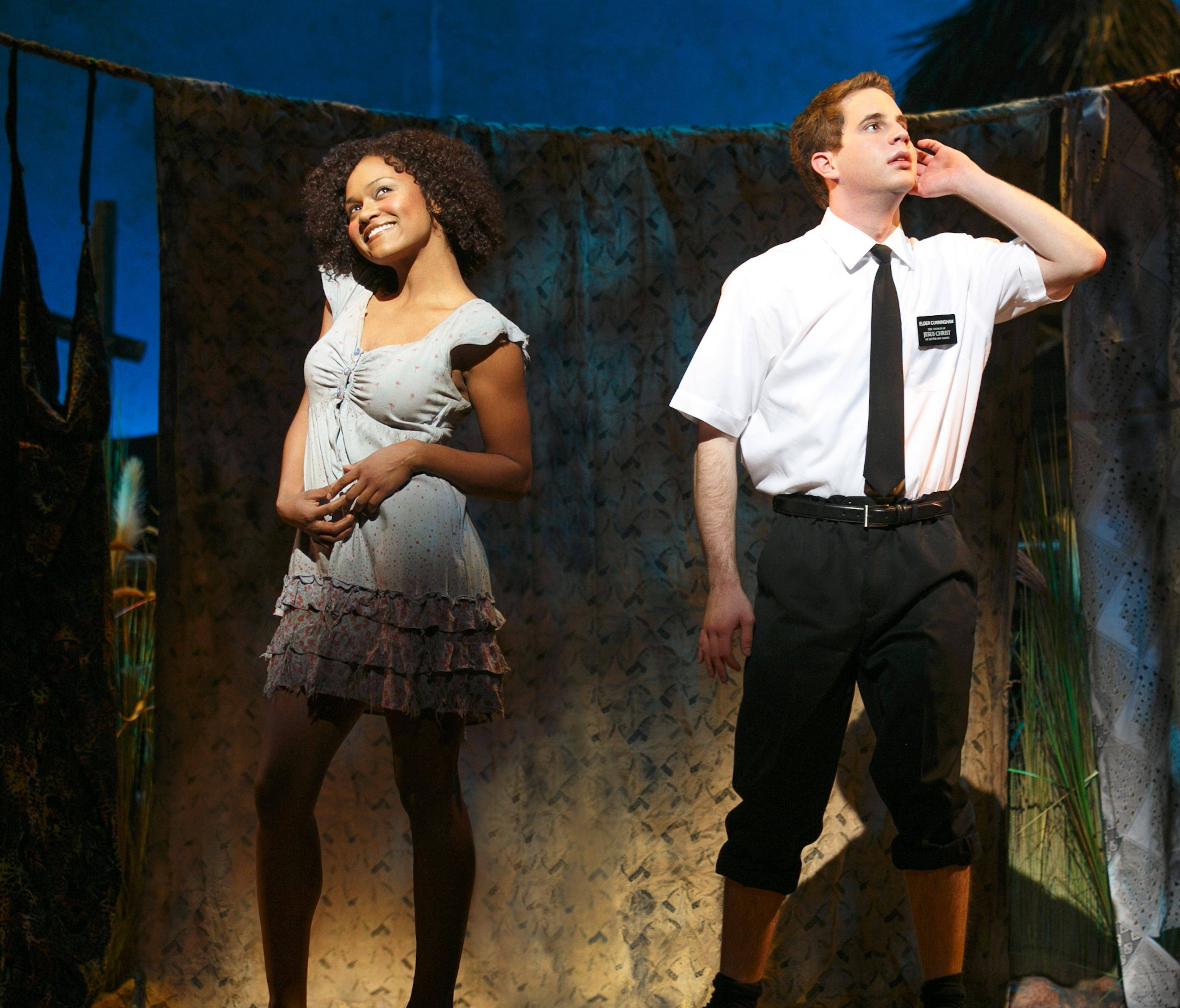 "Nabulungi (Syesha Mercado) and Elder Cunningham (Ben Platt) get excited about baptism in ""The Book of Mormon,"" now at the Bank of America Theatre in Chicago. The second national tour has extended its Chicago run to Sunday, Sept. 8."
