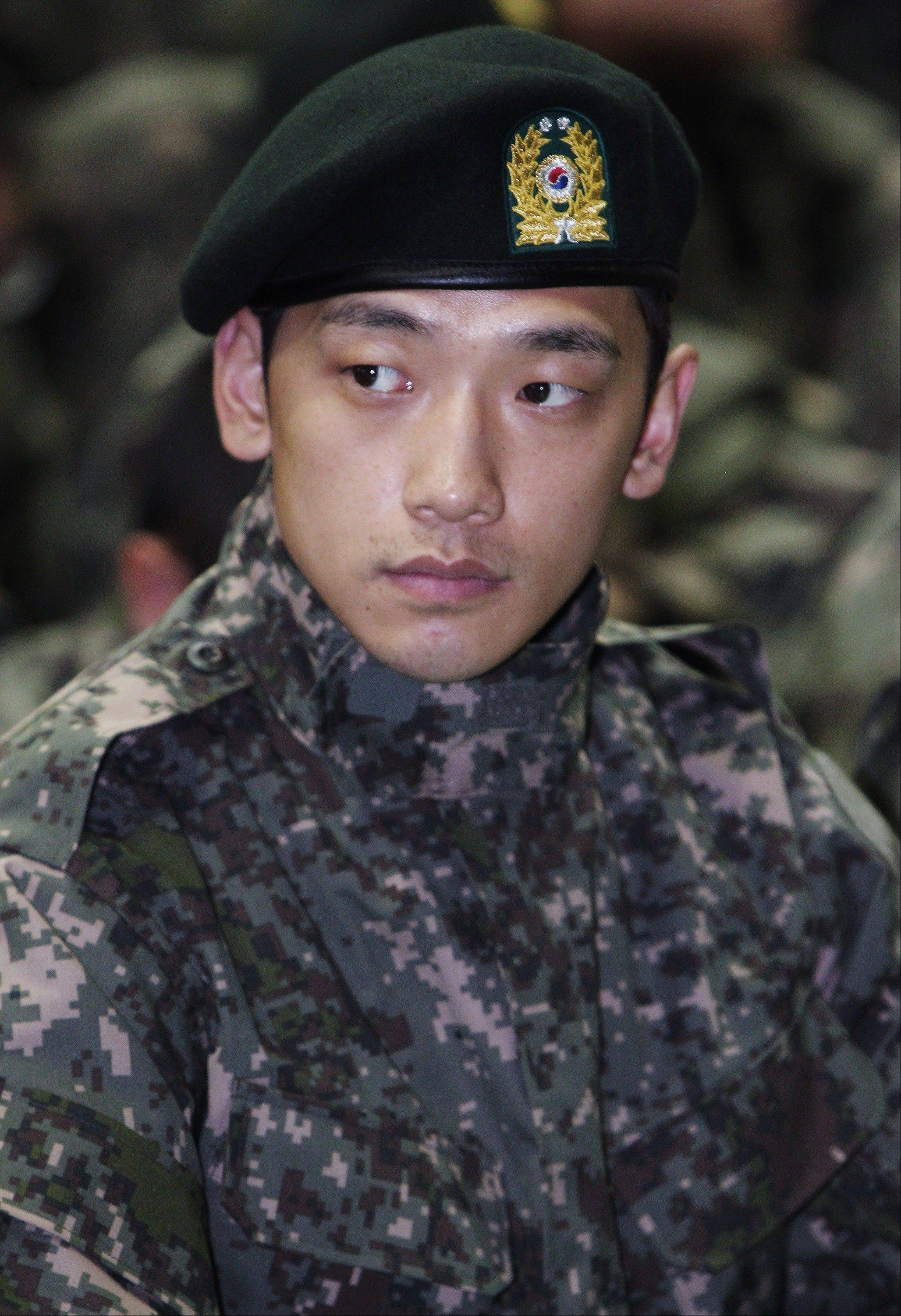 South Korean pop singer Rain is facing questions after paparazzi photos showed him out on the town with a top actress. Seoul�s Defense Ministry said Wednesday it is investigating whether Rain broke military rules by meeting actress Kim Tae-hee while on duty.