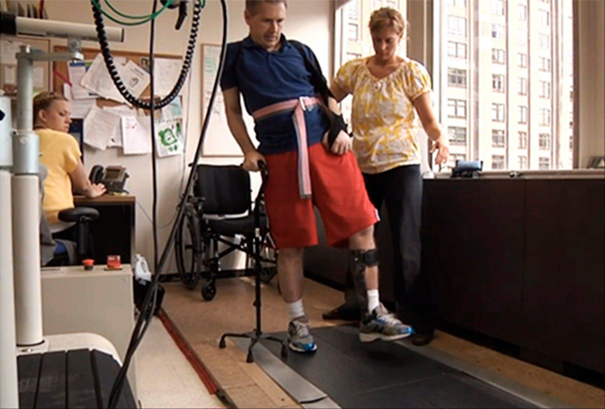 A 2012 file photo of an image taken from video and provided by Sen. Mark Kirk's office shows Kirk going through a walking exercise at the Rehabilitation Institute of Chicago.