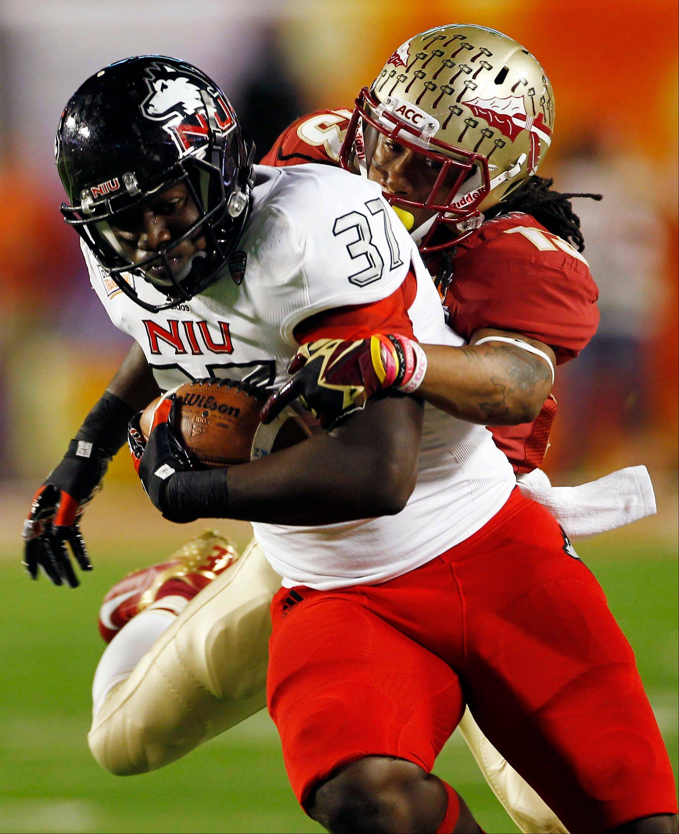 Northern Illinois tight end Desroy Maxwell (37) is tackled by Florida State defensive back Ronald Darby (13) during the first half of the Orange Bowl NCAA college football game, Tuesday, Jan. 1, 2013, in Miami.