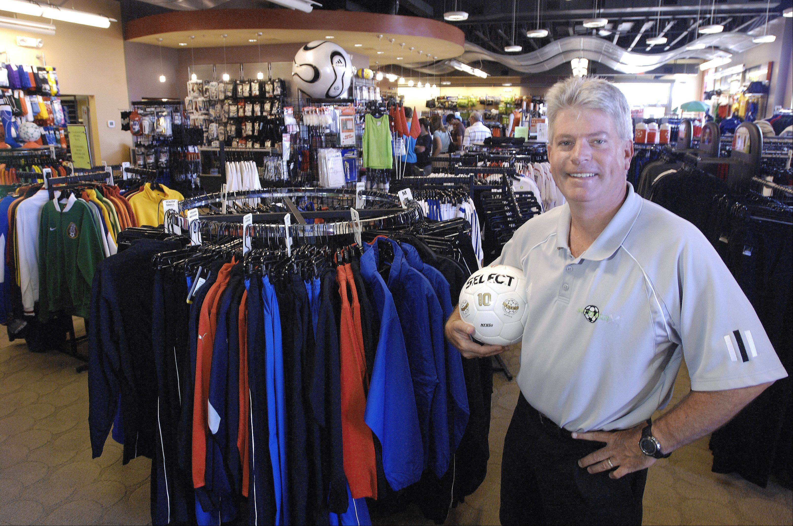 Owner of Soccer Plus, Bob Naughtrip, inside his store in Palatine.