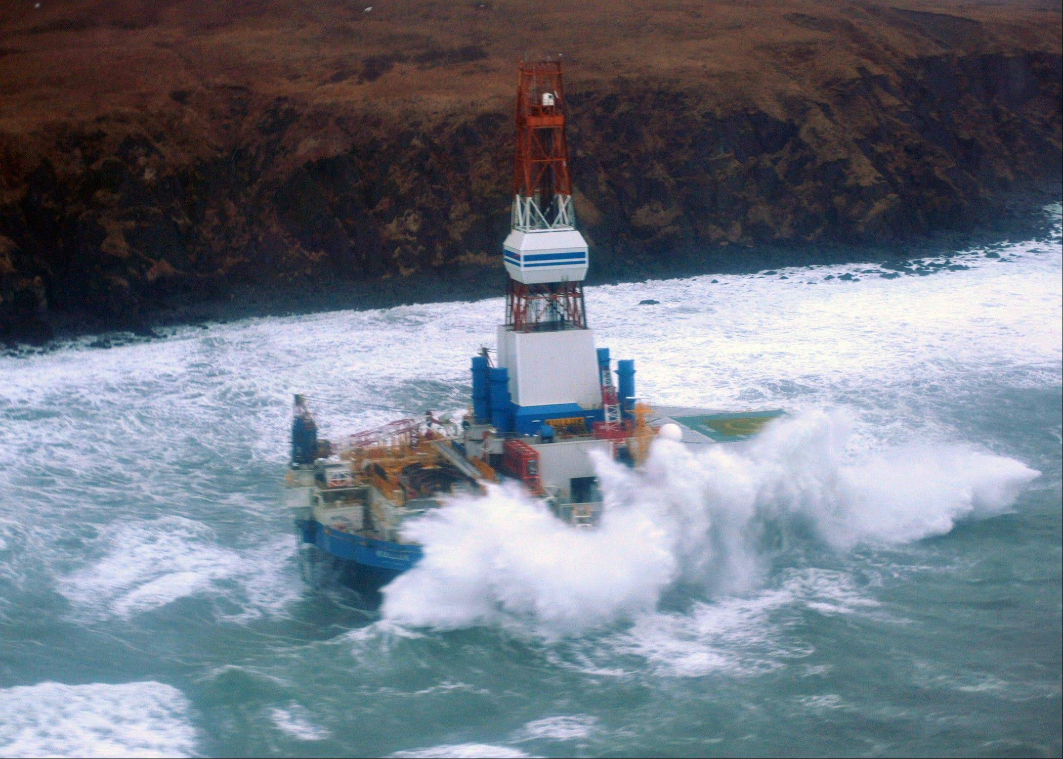 The Royal Dutch Shell drilling rig Kulluk aground off a small island near Kodiak Island.