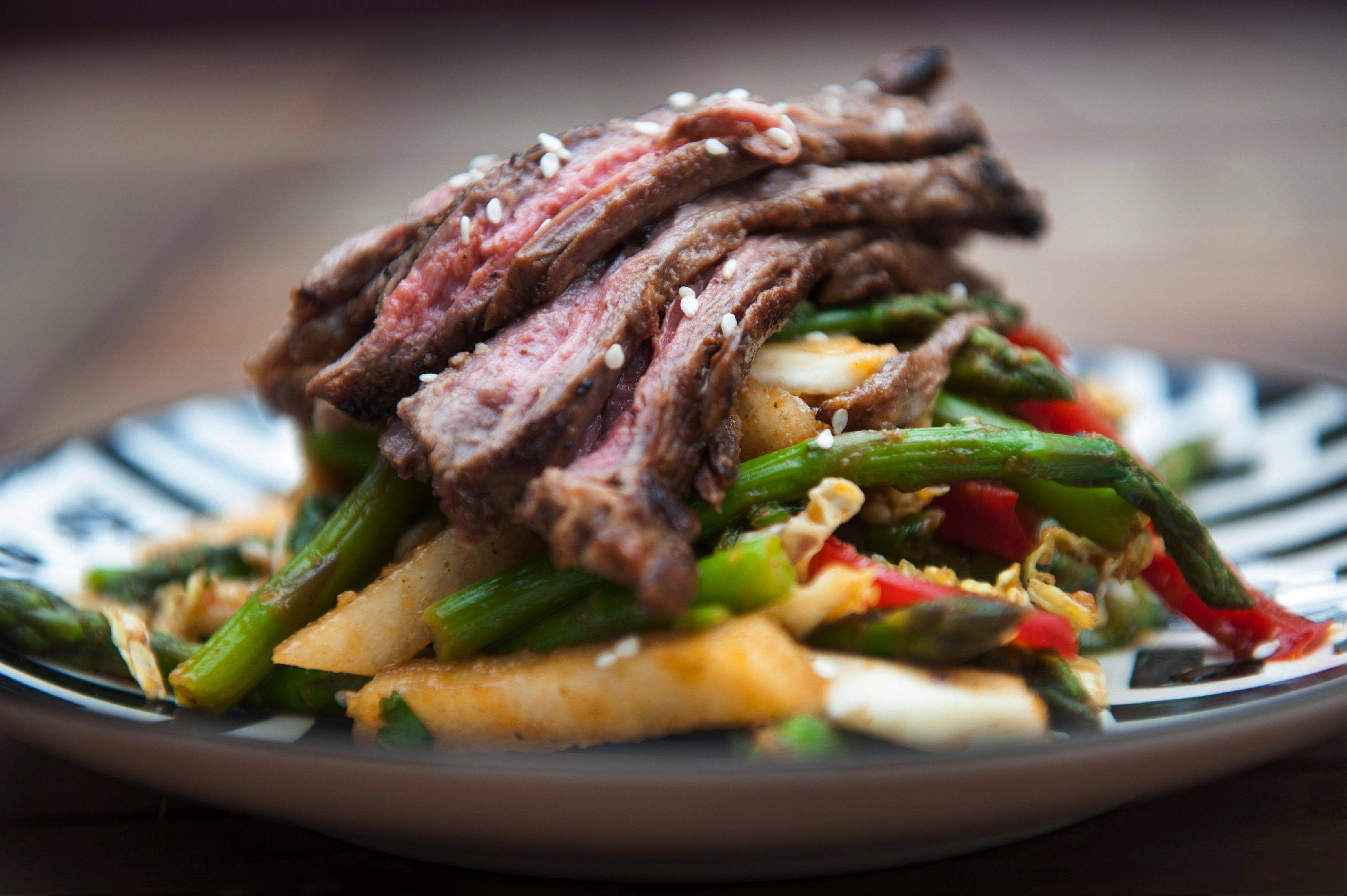 Asian pears contain enzymes that act as meat tenderizers for this Thai Skirt Steak Salad With Asparagus and Asian Pears.