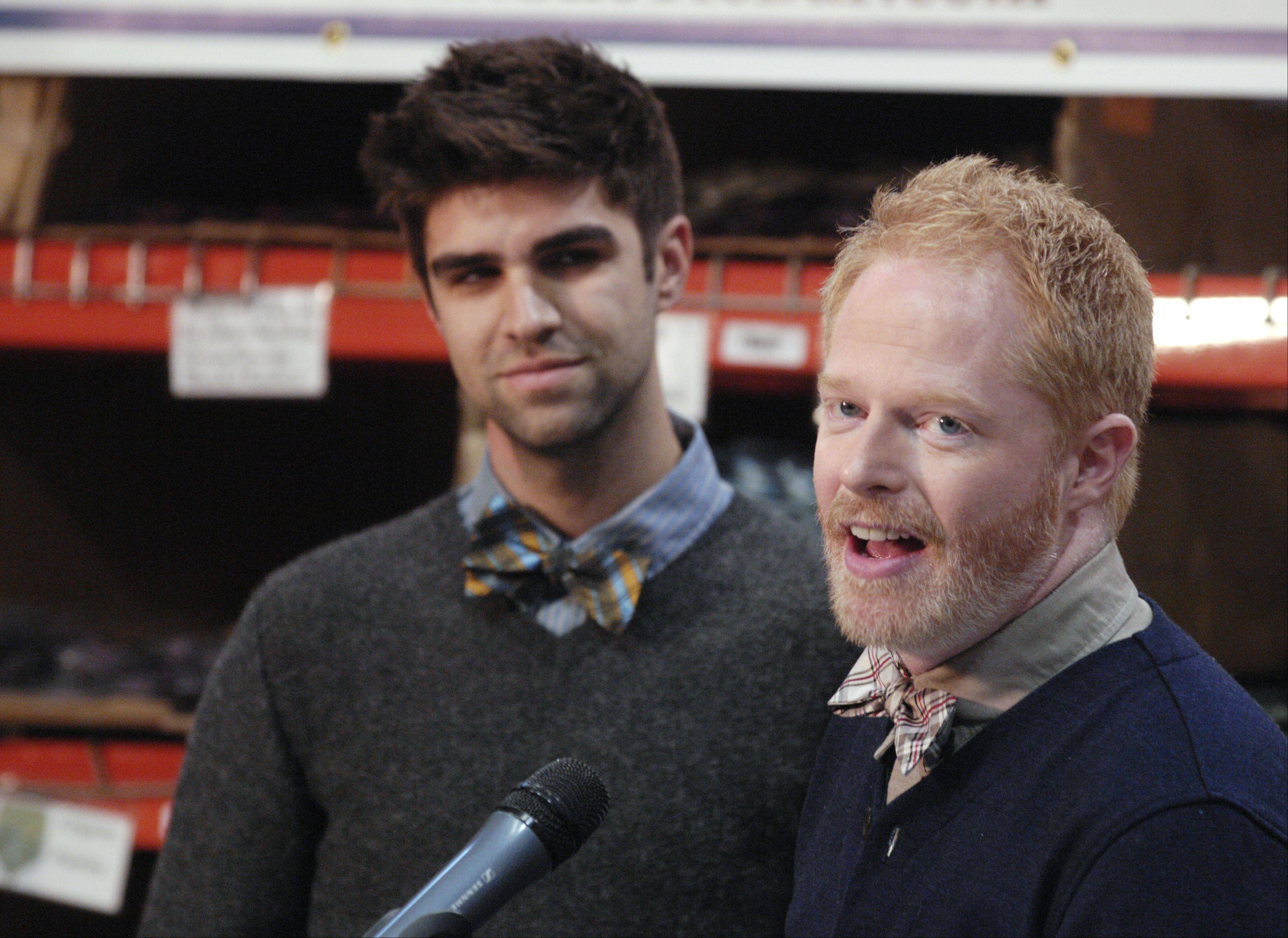 "Jesse Tyler Ferguson, a star on ABC's ""Modern Family,"" and his fiancee Justin Mikita, left, speak Wednesday at The Tie Bar office in Naperville to launch ""Bow Tie Lobby Day"" to support marriage equality."