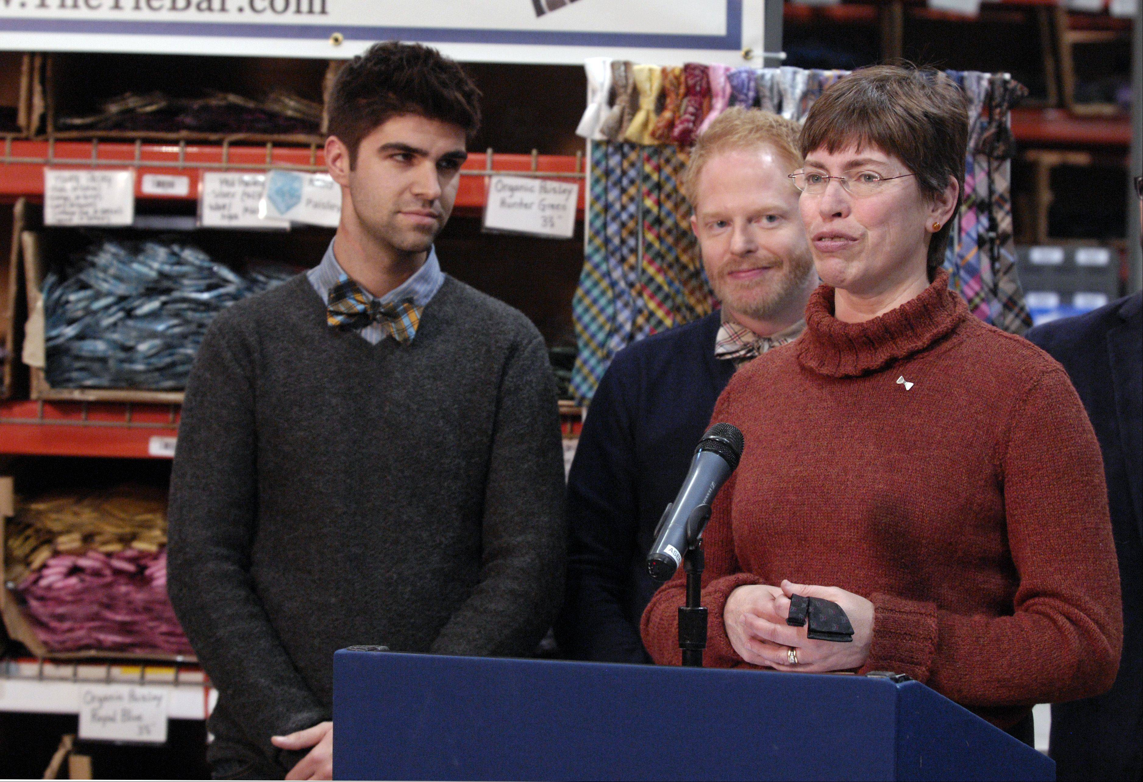 "Lt. Gov. Sheila Simon speaks Wednesday at The Tie Bar office in Naperville with Jesse Tyler Ferguson, a star on ABC's ""Modern Family,"" and his fiancee Justin Mikita, left, to launch ""Bow Tie Lobby Day"" to support marriage equality."