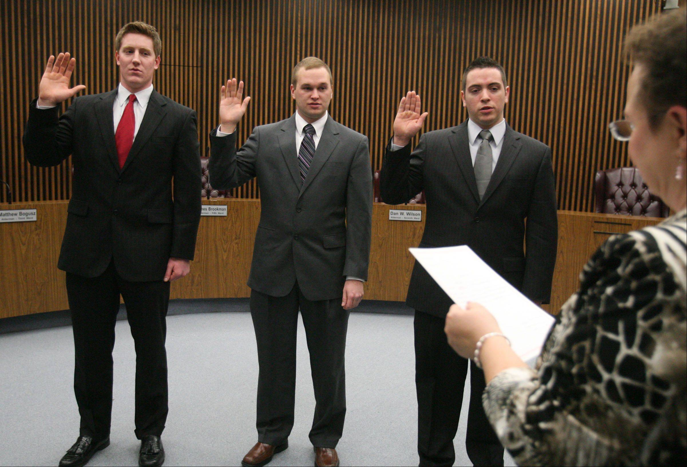 Firefighter paramedics Daniel Garhan, left to right, Patrick Tennant, and Edward Wilson were sworn in Wednesday by Des Plaines City Clerk Gloria Ludwig in the city council chambers at Des Plaines City Hall.