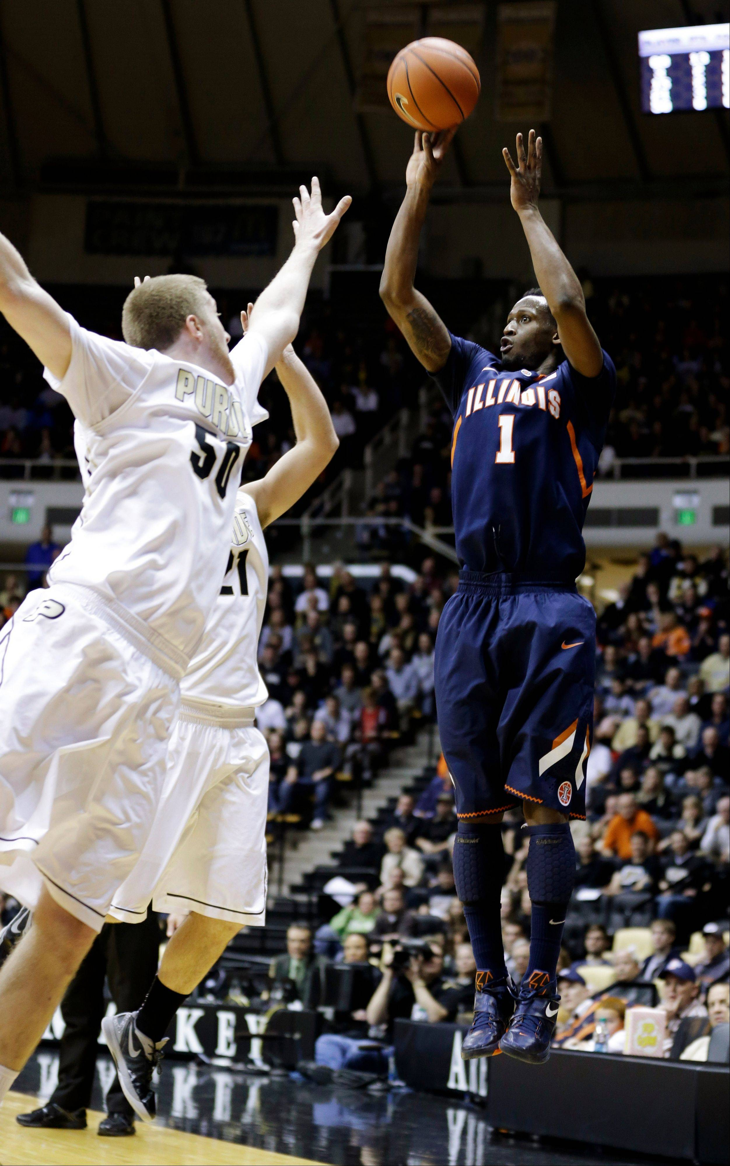 Illinois guard D.J. Richardson (1) shoots over Purdue forwards Travis Carroll (50) and D.J. Byrd Wednesday in West Lafayette, Ind. Purdue beat the No. 11 Illini 68-61
