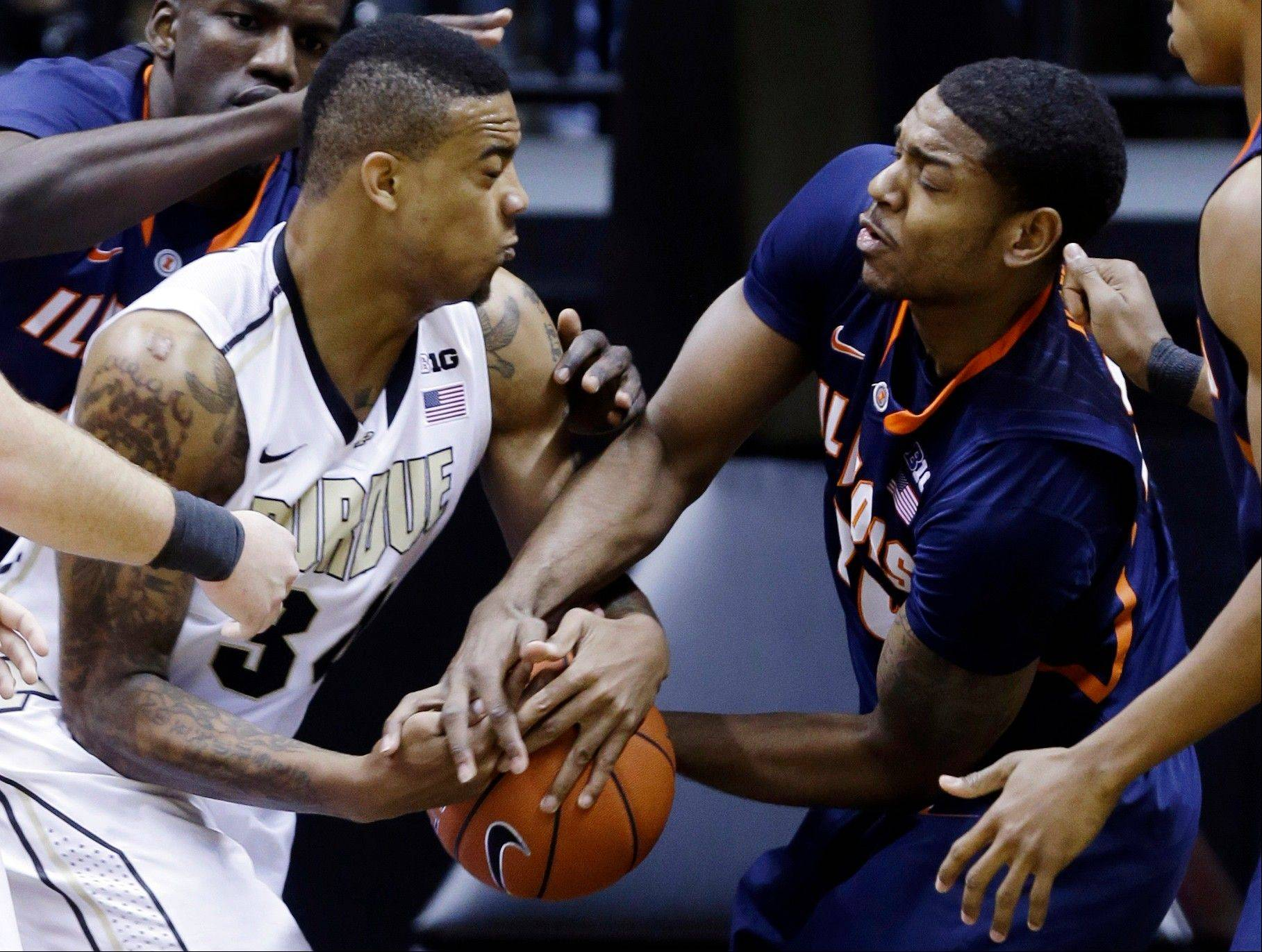 Purdue forward Jacob Lawson, left, and Illinois guard Myke Henry fight for a rebound Wednesday night in West Lafayette, Ind. Purdue beat the No. 11 Illini 68-61
