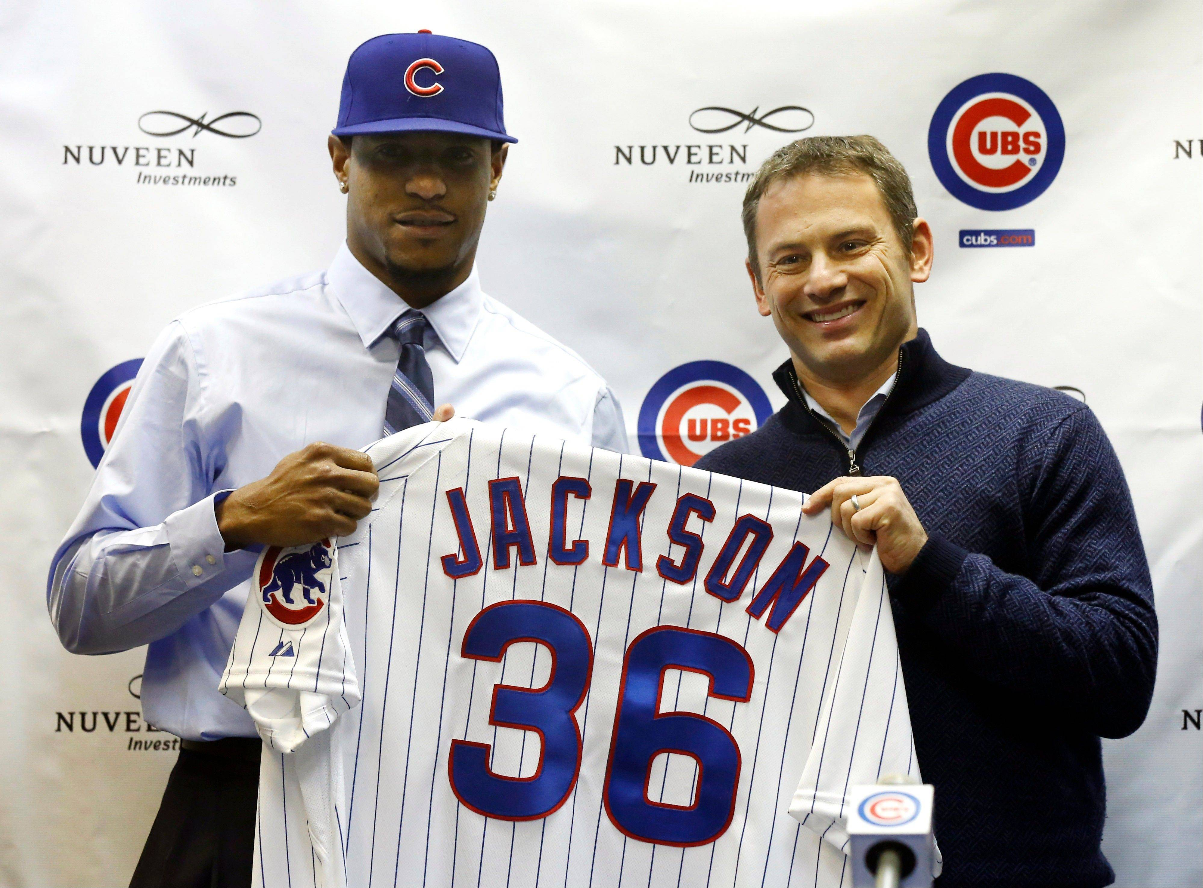 Cubs general manager Jed Hoyer, right, poses with newly signed right-handed pitcher Edwin Jackson during an introductory news conference Wednesday at Wrigley Field.