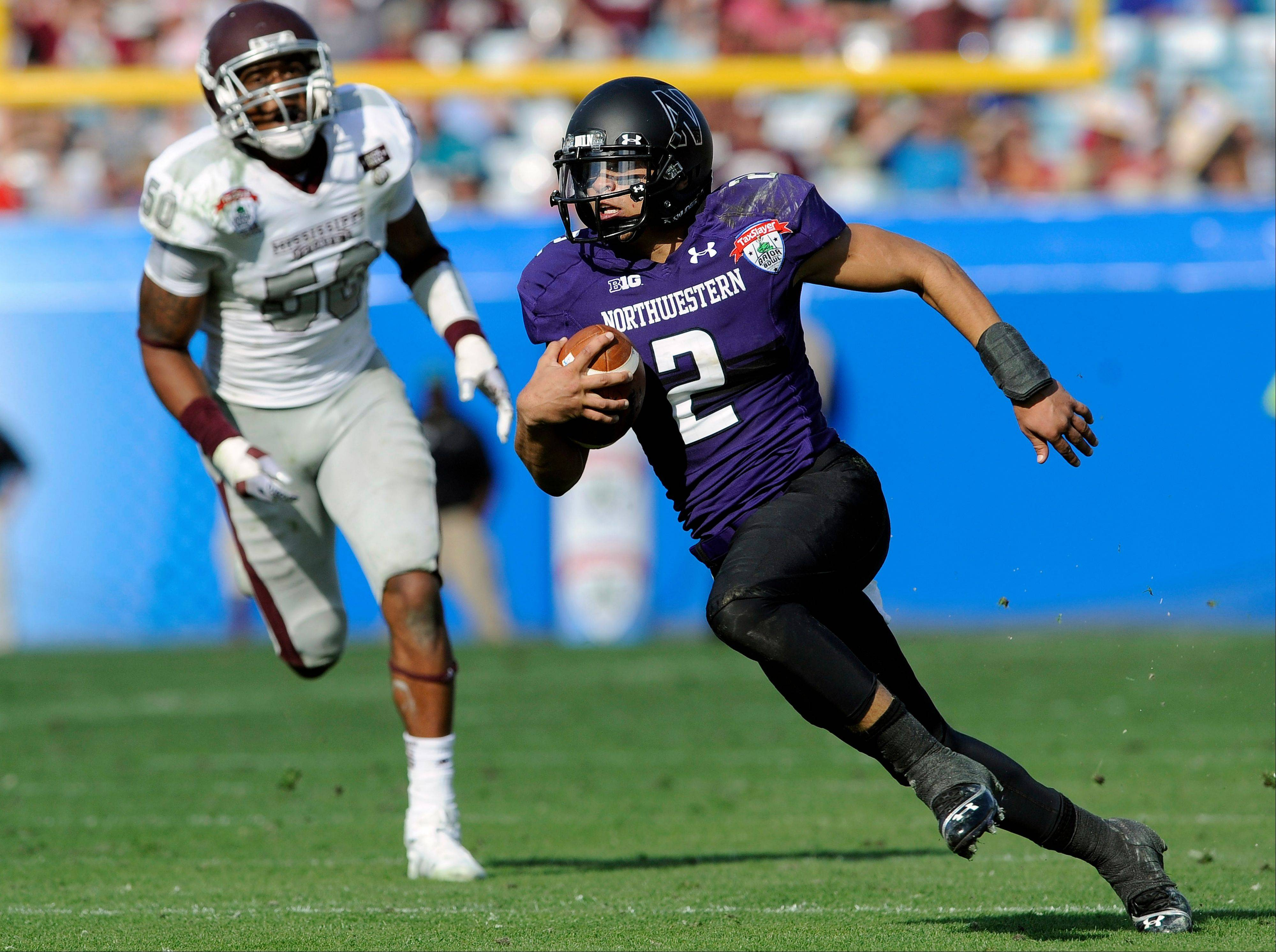 Northwestern quarterback Kain Colter (2) breaks a long run during the second half of the Gator Bowl on Tuesday in Jacksonville, Fla. Northwestern beat Mississippi State 34-20.