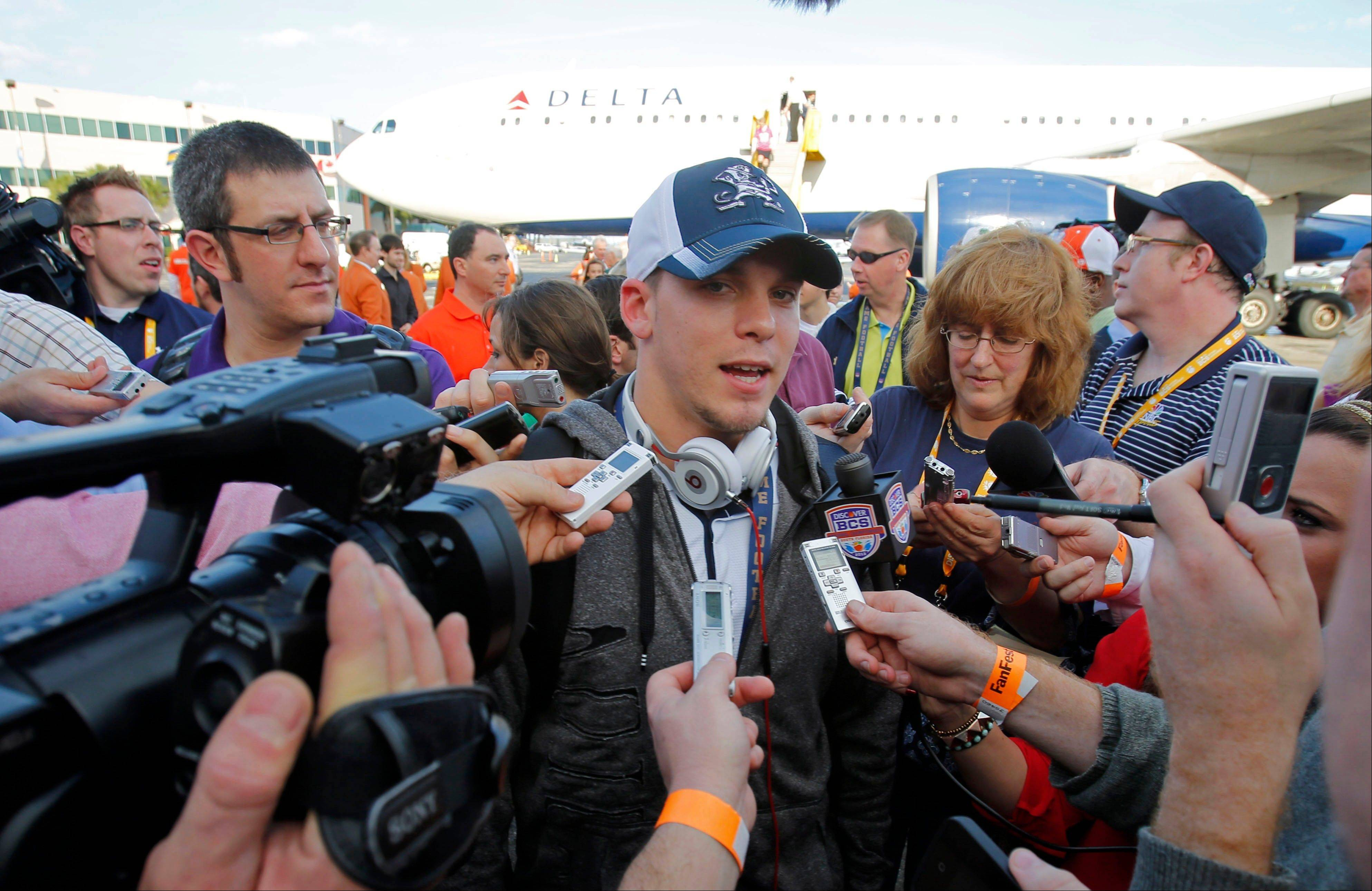Notre Dame wide receiver Robby Toma talks to reporters Wednesday after arriving in Fort Lauderdale, Fla.