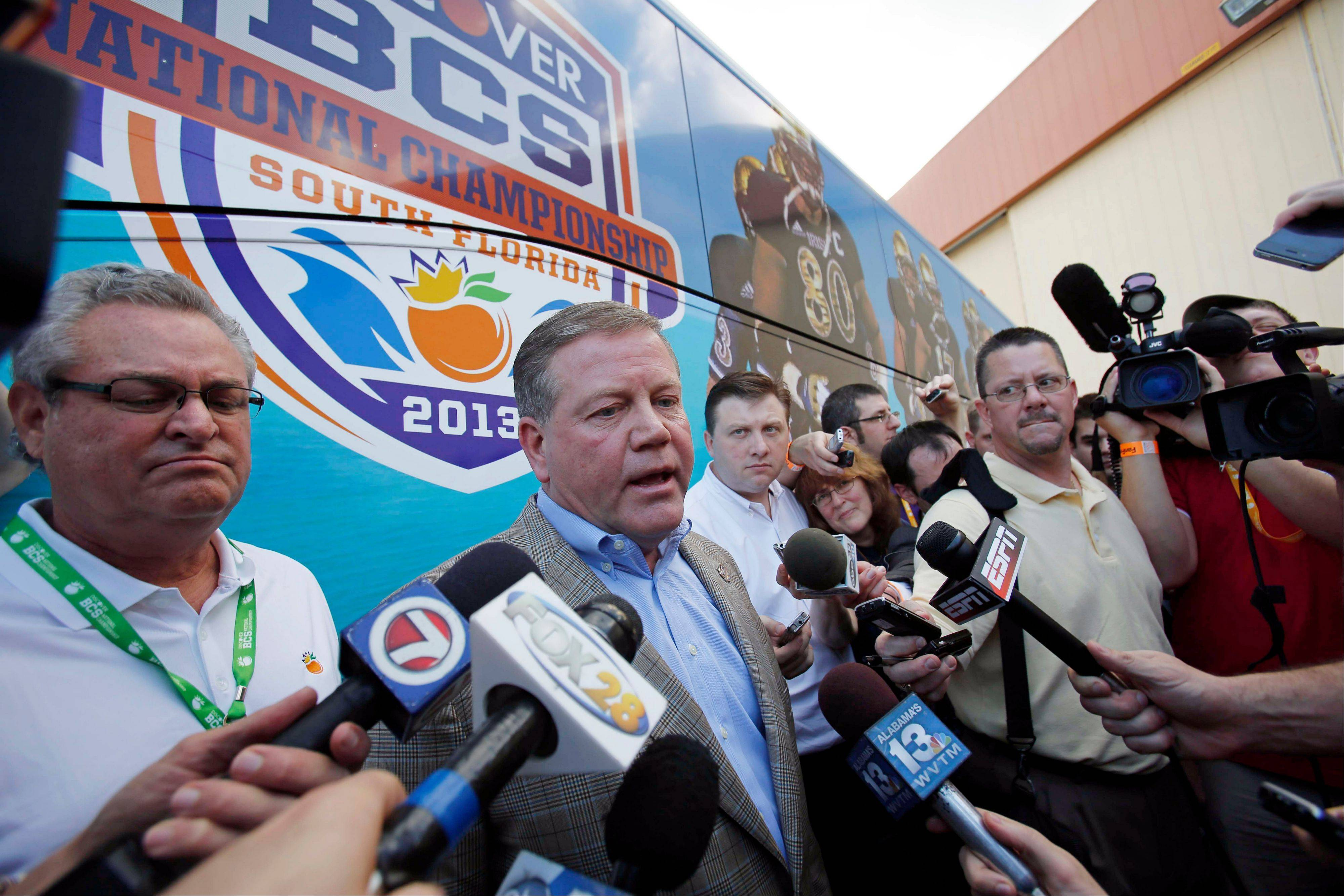 Notre Dame head coach Brian Kelly talks to reporters Wednesday after arriving in Fort Lauderdale, Fla. Notre Dame takes on Alabama in the BC national championship NCAA college football game next Monday in Miami.