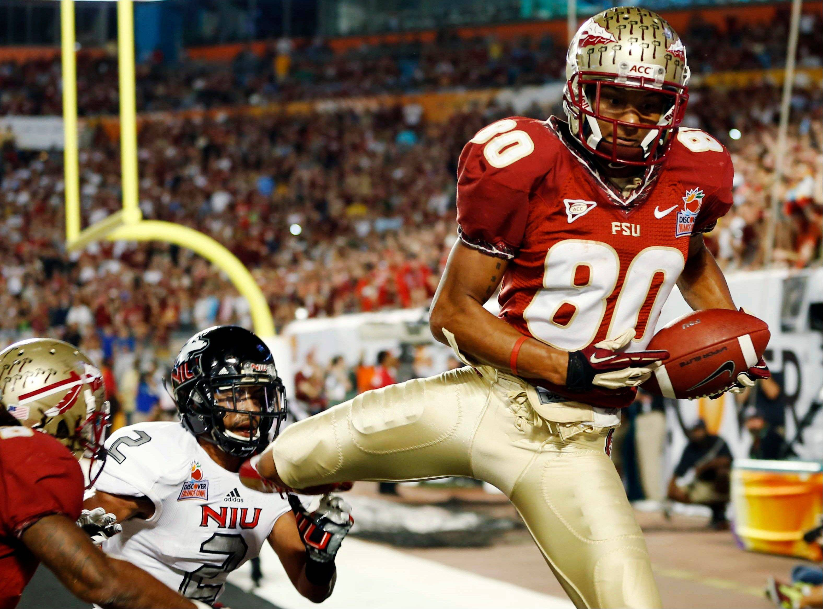 Florida State wide receiver Rashad Greene (80) pulls in a touchdown in the end zone during the first half of the Orange Bowl NCAA college football game against Northern Illinois, Tuesday, Jan. 1, 2013, in Miami.