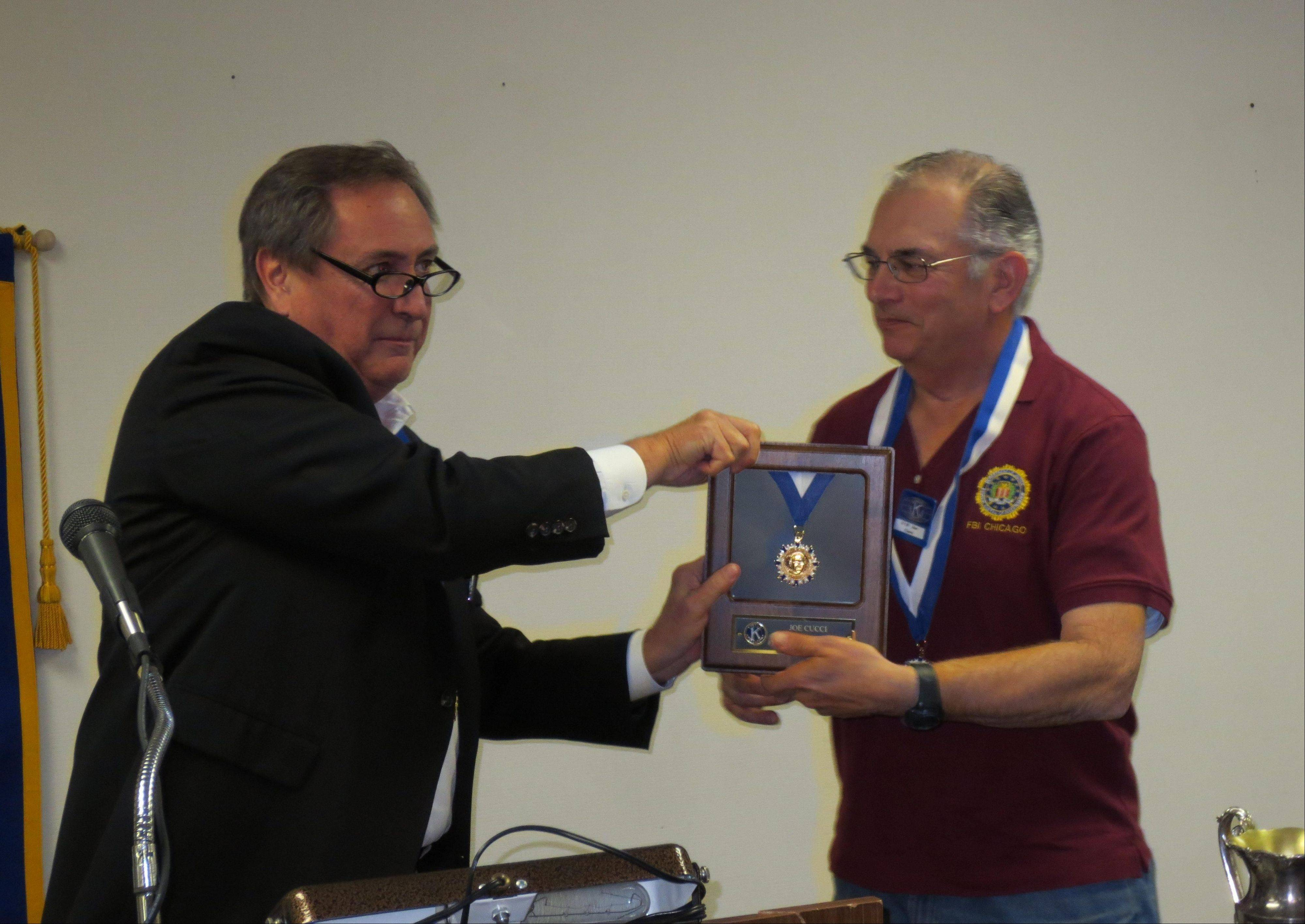 St. Charles Noon Kiwanis member Joe Boyd, left, gives past president Joe Cucci the Hixson Award, the highest Kiwanis award to an individual for 2012. Boyd, a past Hixson Award recipient, went through the lengthy list of contributions Cucci has made to the club and the community.