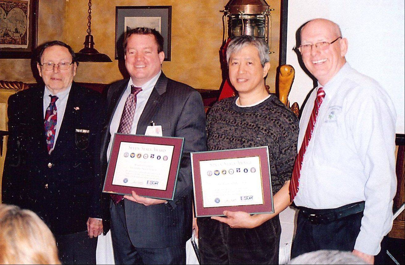 From left, Veterans Assistance Commission president Norm Arnswald, Michael Smith of Rosalind Franklin Health Services, Dr. Raymond Moy of Vernon Hills and VAC Superintendent Michael Peck. Smith and Moy were honored for their contributions during the 2012 stand down attended by about 240 veterans.