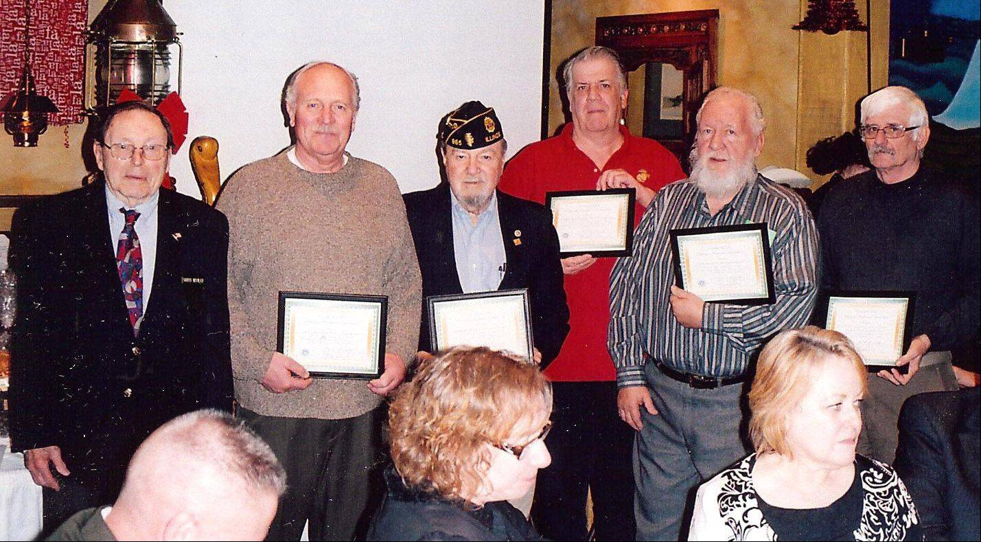 Norm Arnswald, left, president of the Veterans Assistance Commission of Lake County, presents the Johnnie Allen Award for top volunteer hours. The recipients were: Wally Frazier of the Mundelein American Legion; John Shebenik of the Zion-Benson American Legion; Oliver Davidson of Marine Corps League 801; John Patterson of the Winthrop Harbor VFW; and Mike Kozar of the Lake Zurich American Legion.