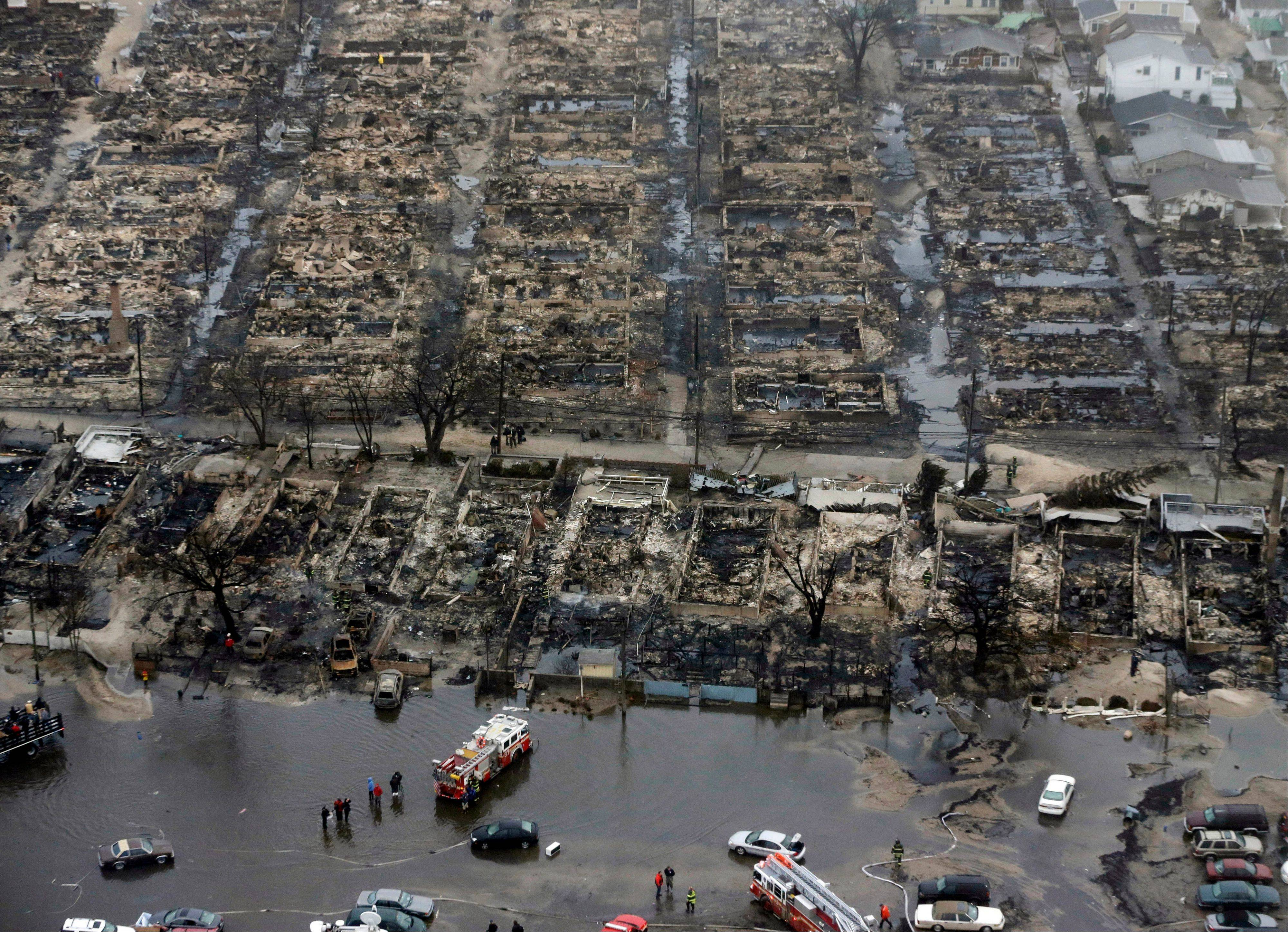 An aerial view of burned-out homes in the Breezy Point section of the Queens borough New York after a fire in the beachfront neighborhood as a result of Superstorm Sandy. Munich Re estimated insured losses from Sandy at $25 billion and total losses at $50 billion.