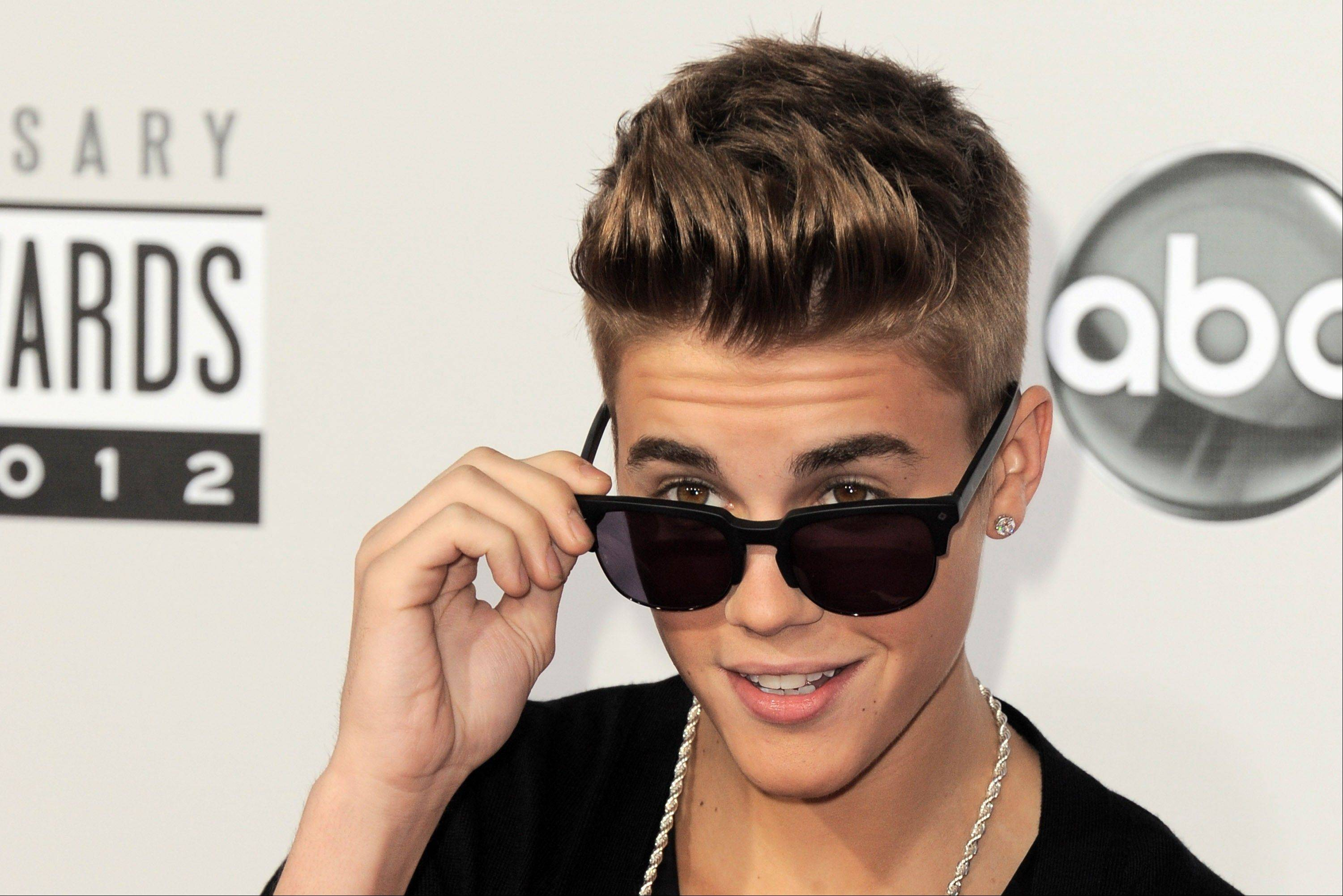 Police say a paparazzo was hit by a car and killed after taking photos of Justin Bieber�s white Ferrari on a Los Angeles street Tuesday. Police say Bieber was not in the Ferrari at the time.