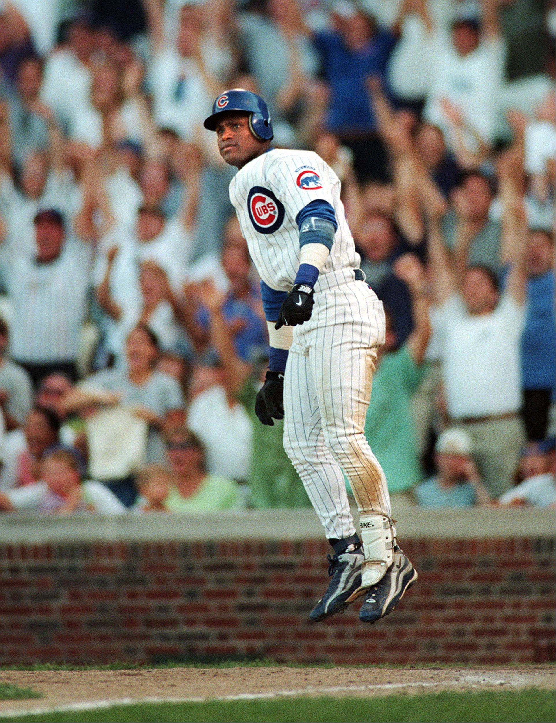 Sammy Sosa does his hop after hitting his 60th home run on Sept. 12, 1998, tying Babe Ruth�s record at the time for home runs in a season. The next day Sosa hit 2 more at Wrigley Field.