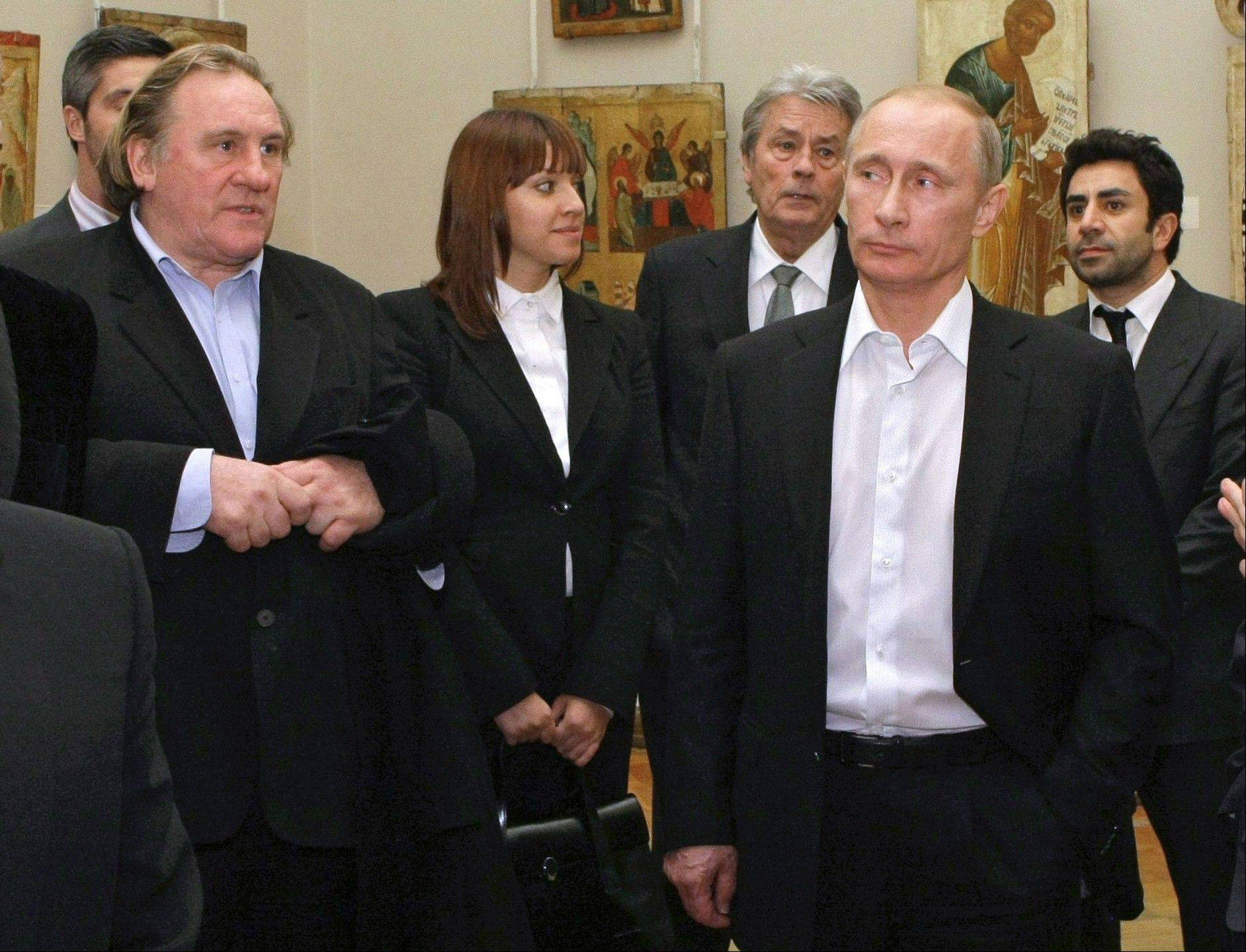 Russian Prime Minister Vladimir Putin, right, and French actor Gerard Depardieu, left, attend the Russian Museum, in St. Petersburg. Gerard Depardieu, the French actor who has been sparring with his native country over taxes, has been granted Russian citizenship. A brief announcement on the Kremlin website Thursday said President Vladimir Putin signed the citizenship grant.