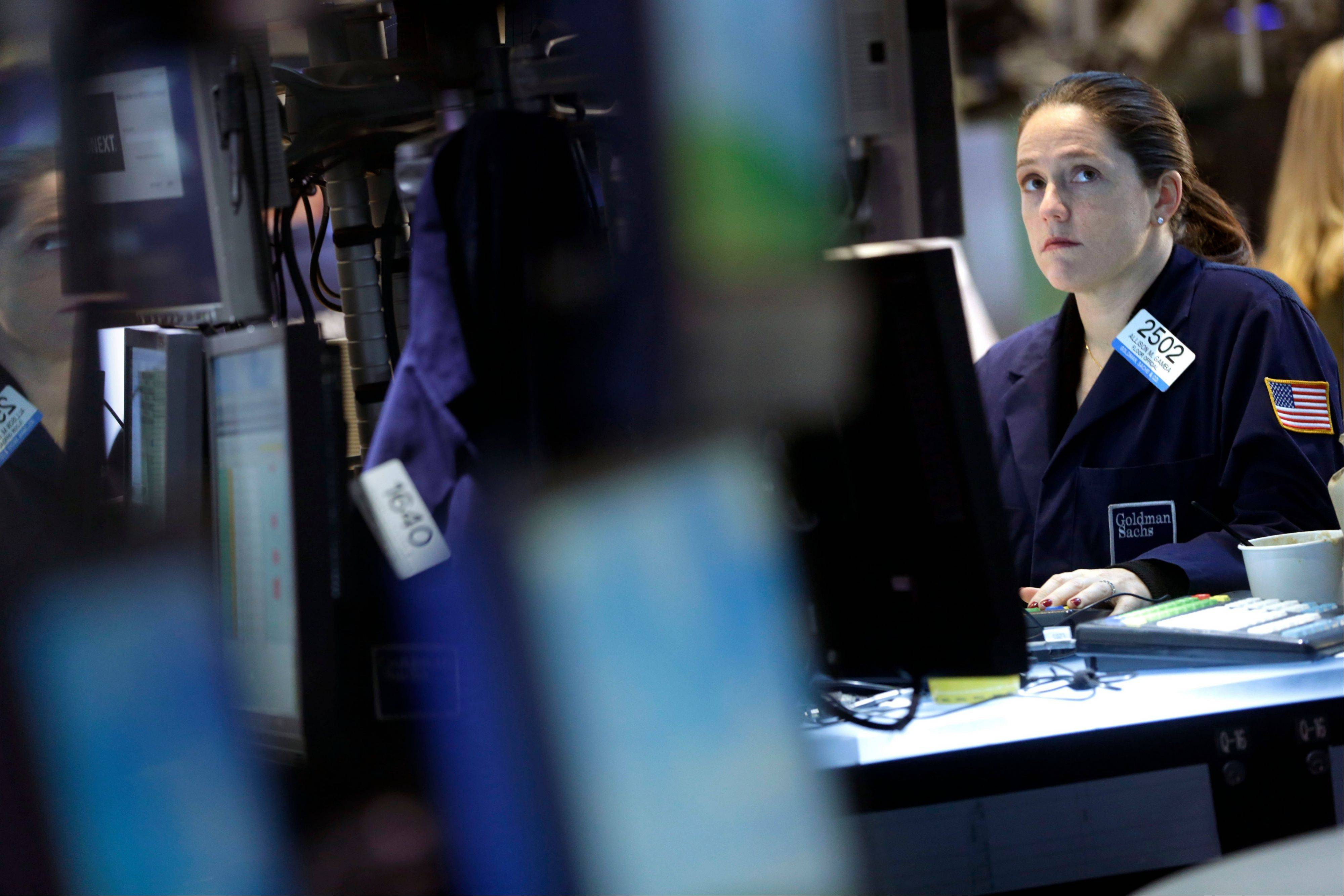 A trader works on the floor Monday at the New York Stock Exchange in New York. Asian stocks rose Thursday, a day after the U.S. reached a deal to stave off the so-called fiscal cliff, but enthusiasm waned by the time European markets opened.