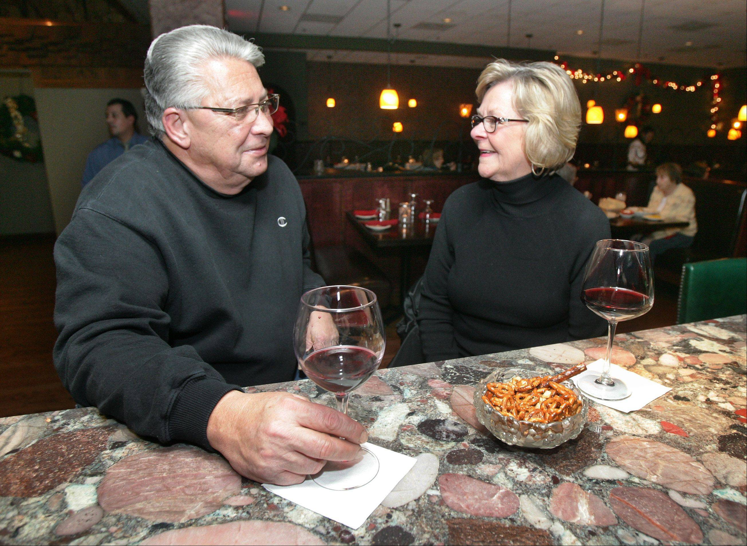 John and Jann Coroneos of Libertyville enjoy glasses of wine at Bodega Grill & Wine Lounge in Gurnee.