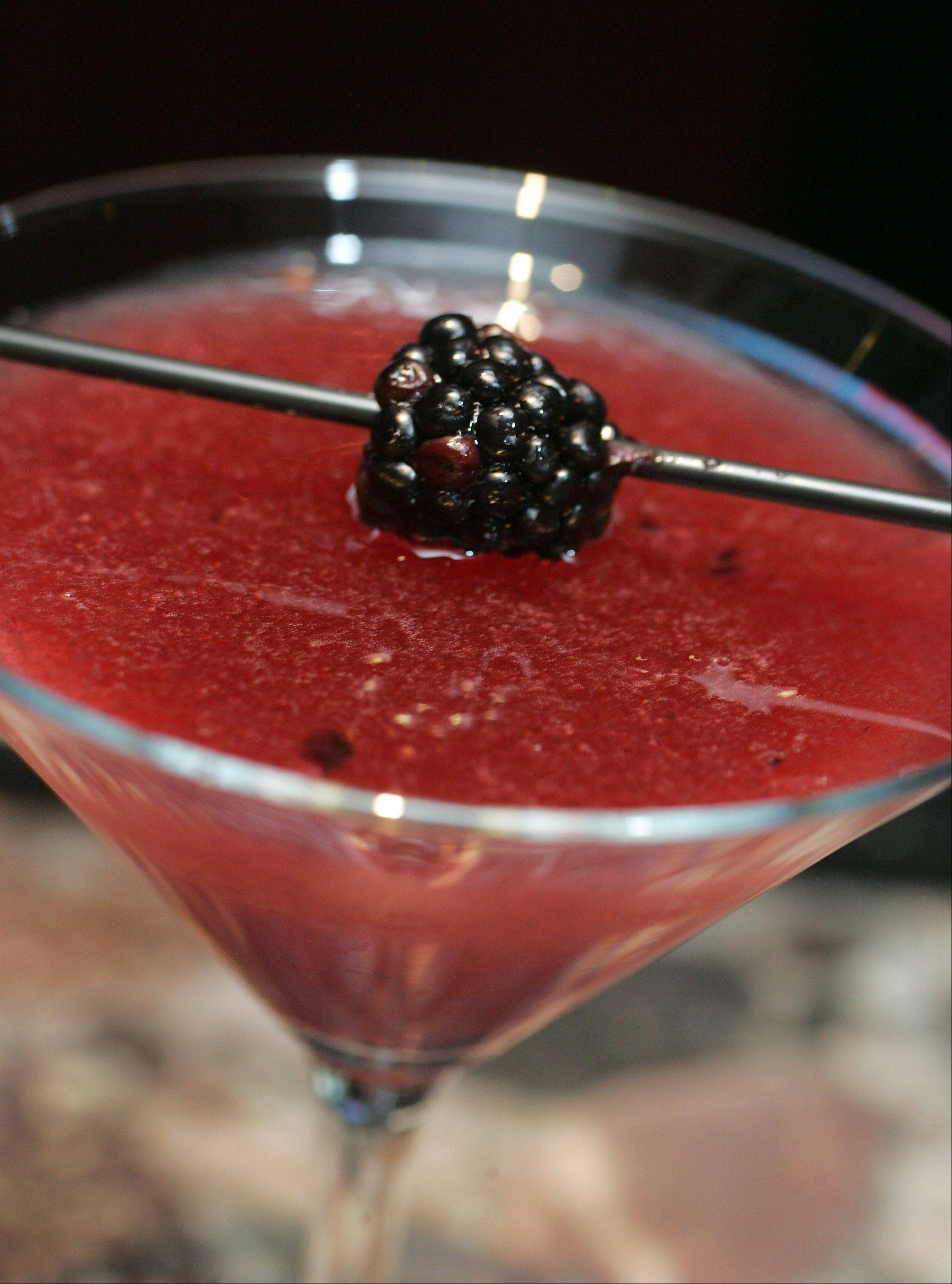 The Bodega Martini is made with Figenza Fiz vodka, muddled blackberries and Prosecco.