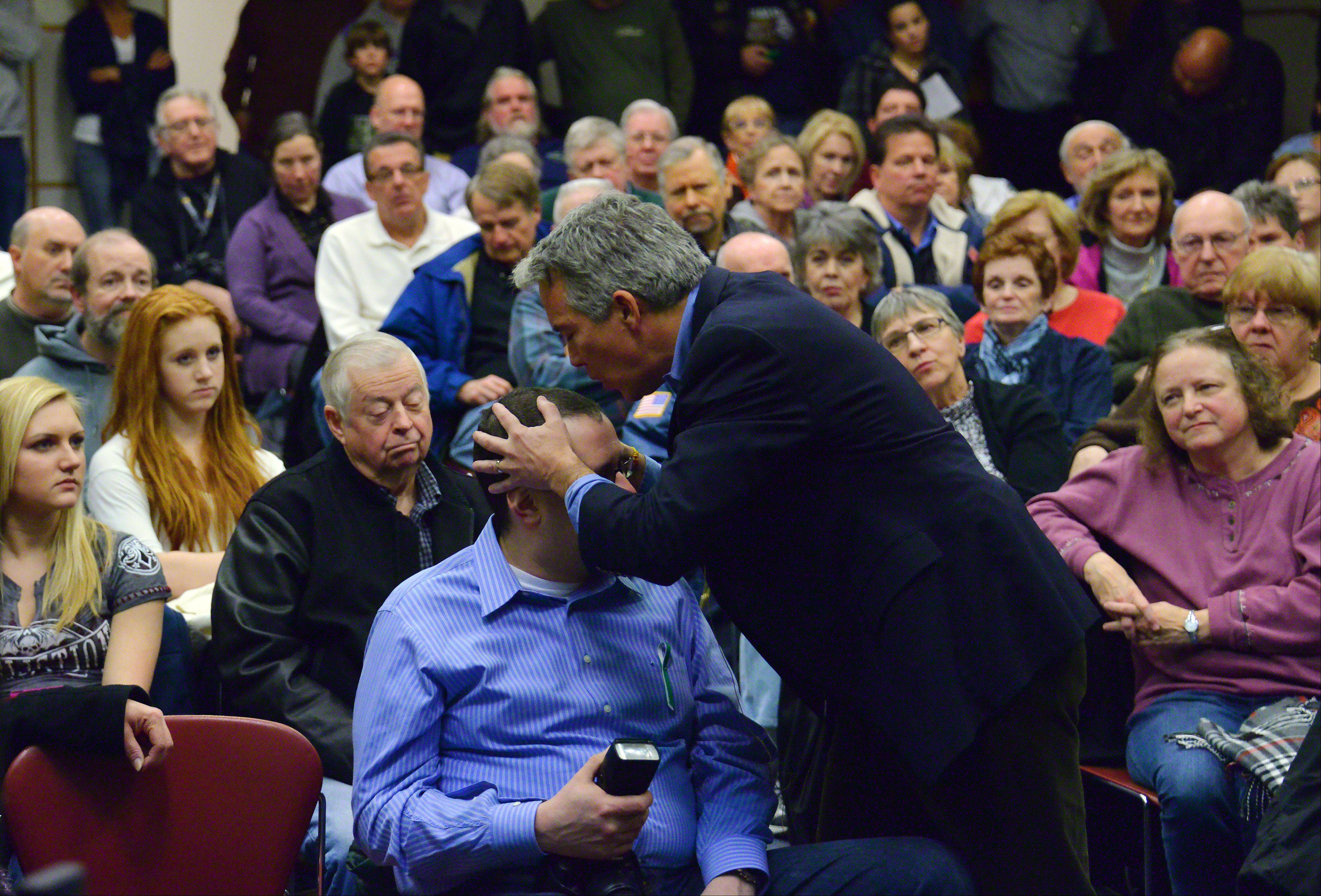 Former U.S. Rep. Joe Walsh made his first public appearance as an ex-congressman at the Arlington Heights Memorial Library on Thursday night and spoke to over 100 people. Walsh used one of those people, Carl Arriaza of Mount Prospect, to make a point as he talked about the country's future.