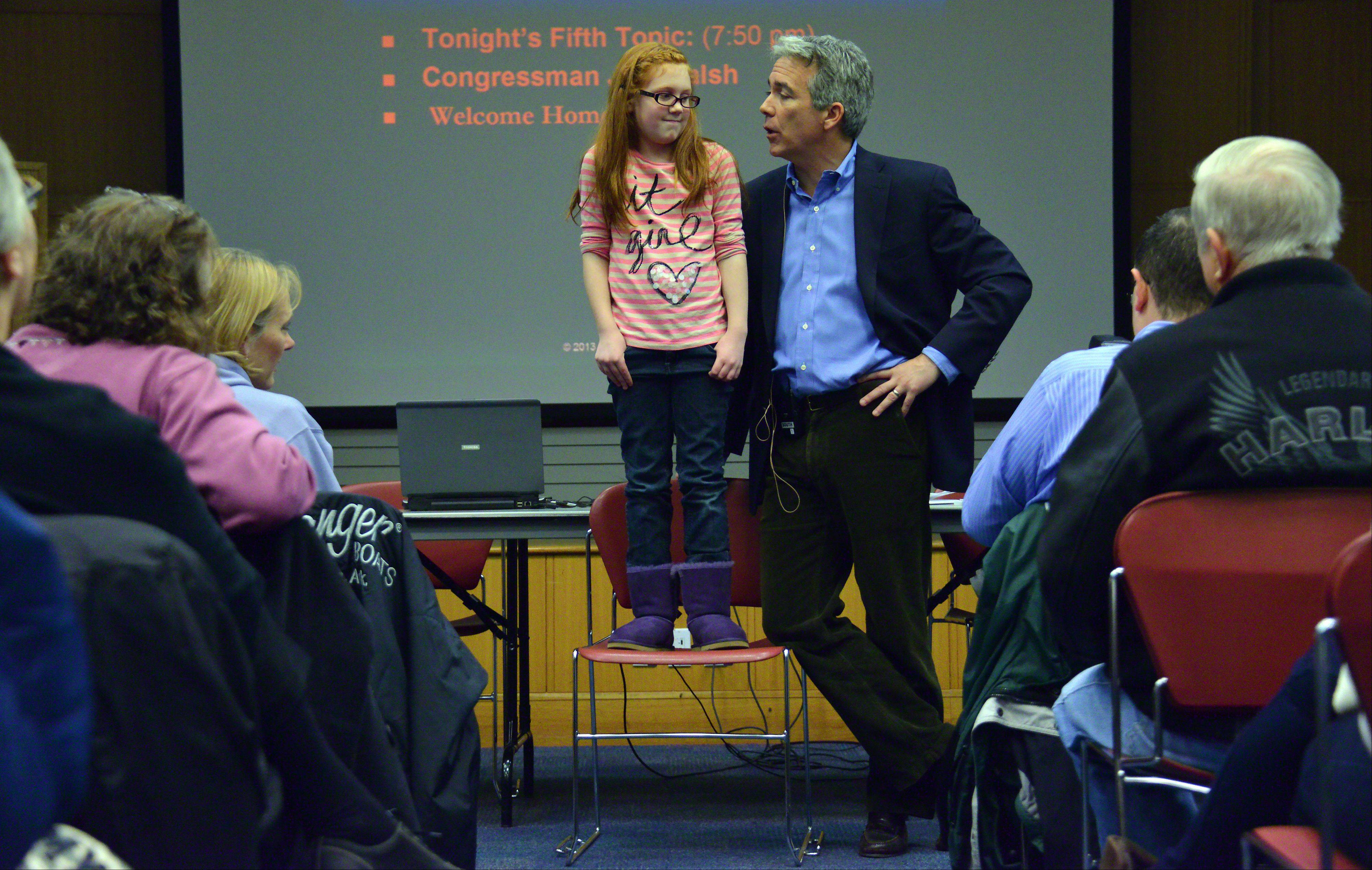 Former U.S. Rep. Joe Walsh made his first public appearance as an ex-congressman at the Arlington Heights Memorial Library on Thursday night and spoke to over 100 people. Walsh talked about the country's future with Isabelle Beaman, 9, of Wheaton, next to him.