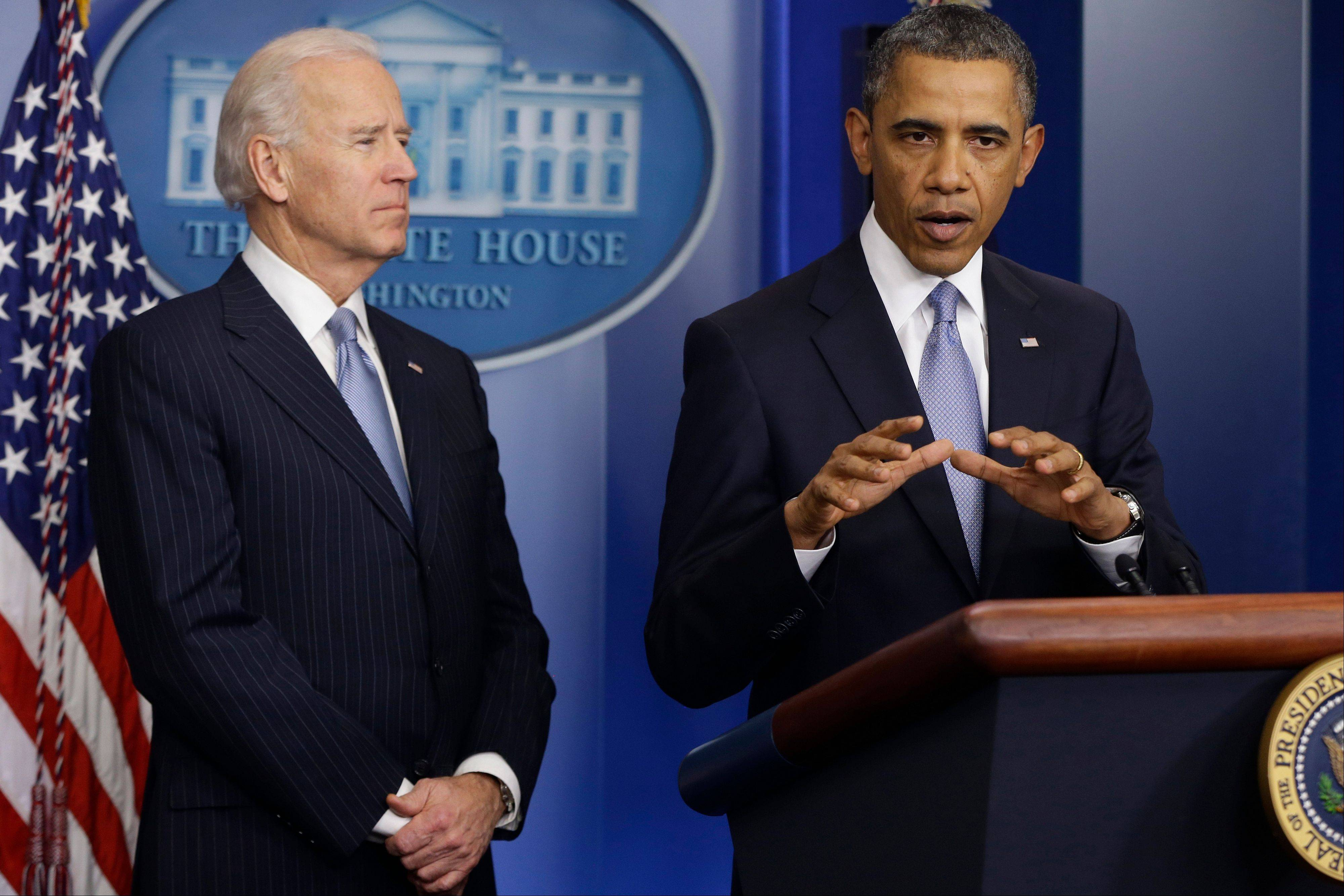 President Barack Obama and Vice President Joe Biden make a statement regarding passage of the fiscal cliff bill in the White House press briefing room Tuesday.