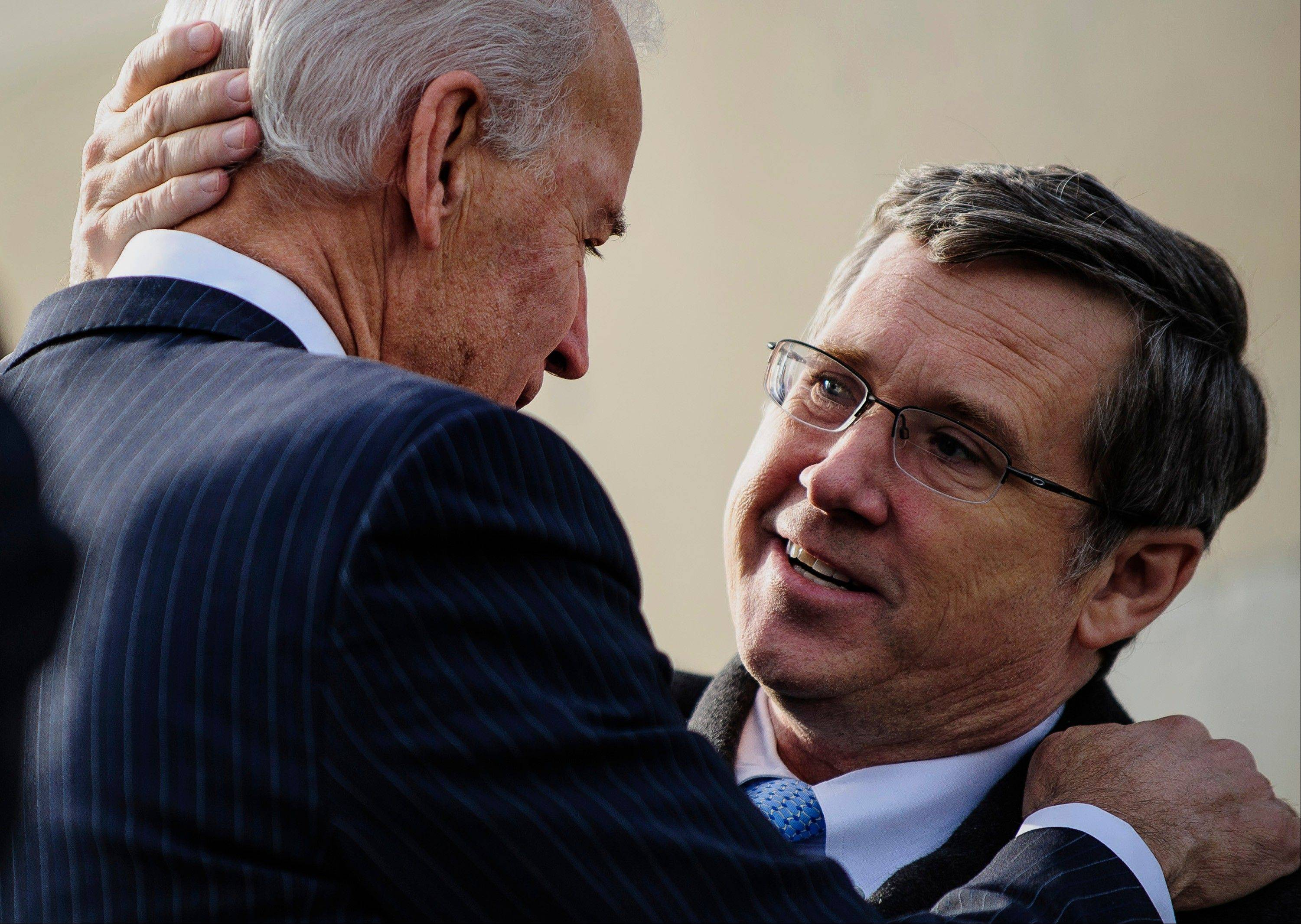 "Vice President Joseph ""Joe"" Biden, left, greets Senator Mark Kirk, a Republican from Illinois, on the steps of the U.S. Capitol in Washington, D.C., U.S., on Thursday, Jan. 3, 2013. Kirk returned for the first time since he suffered a stroke on Jan. 23, 2012."