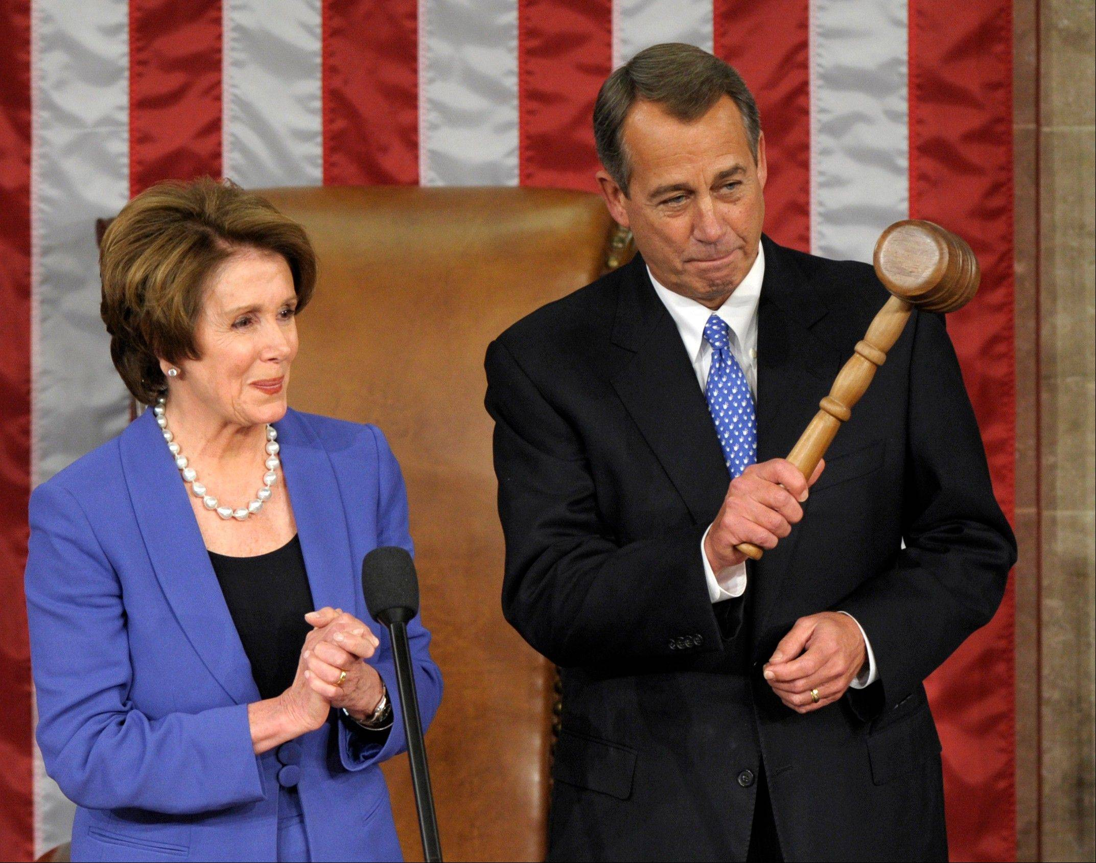 House Minority Leader Nancy Pelosi of California applauds after handing the gavel to House Speaker John Boehner of Ohio, who was re-elected as House Speaker of the 113th Congress on Thursday.