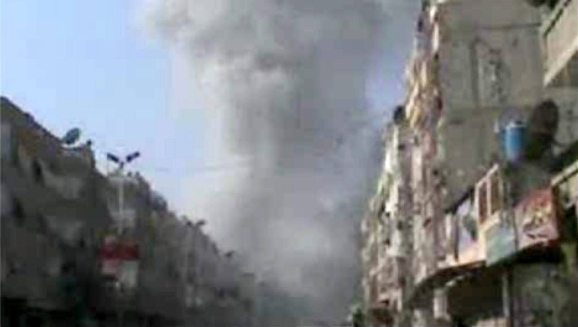 In this image taken from video obtained from Bambuser, which has been authenticated based on its contents and other AP reporting, smoke rises from buildings Thursday after an airstrike hit Douma City, Syria. Airstrikes continued across Syria on Thursday as Syrian President Bashar Assad's military stepped up its assault on areas that surround the nation's capital.