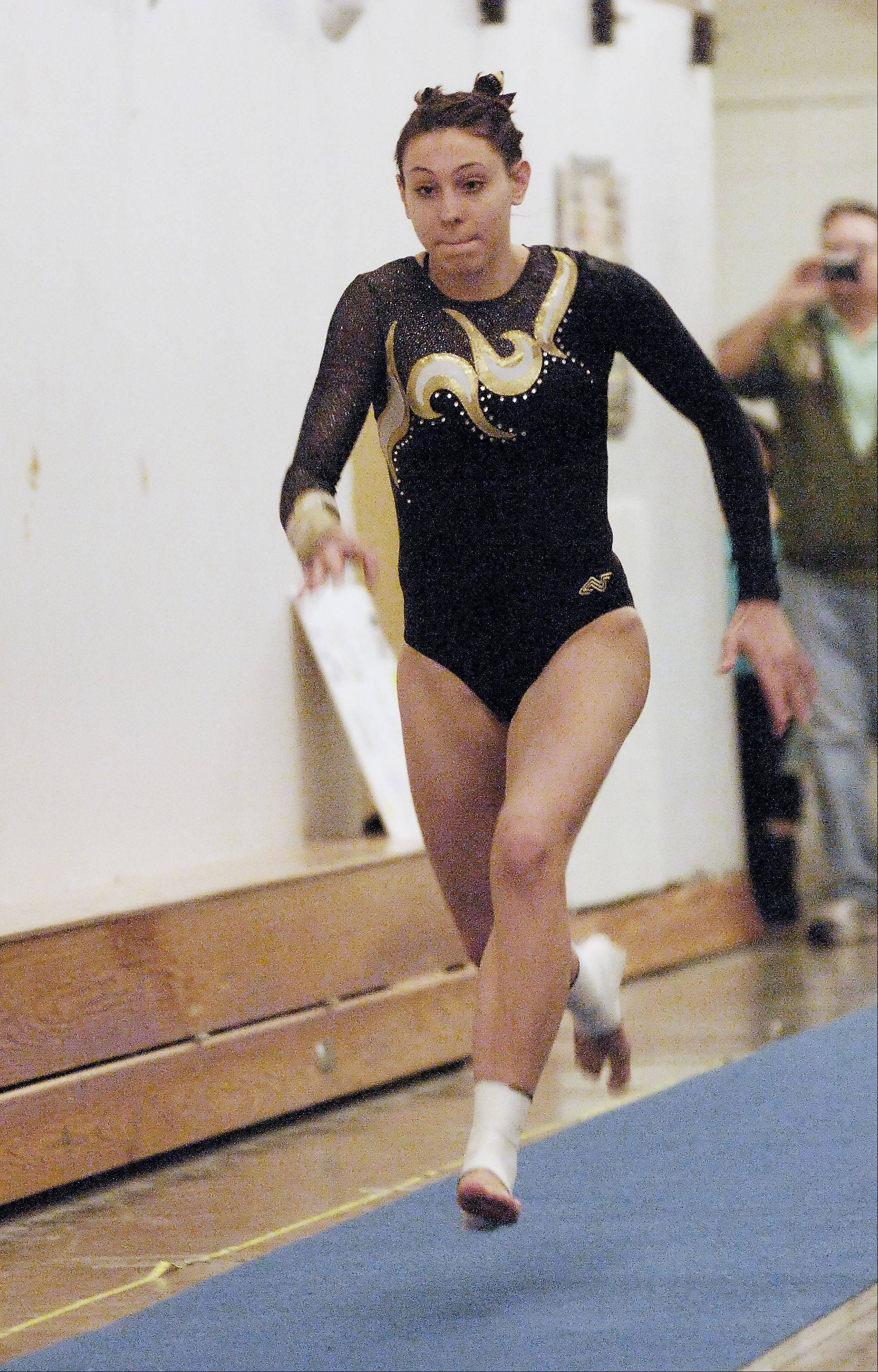 Mariah Matesi of Glenbard North performs on vault during Thursday's girls gymnastics meet against Naperville North.