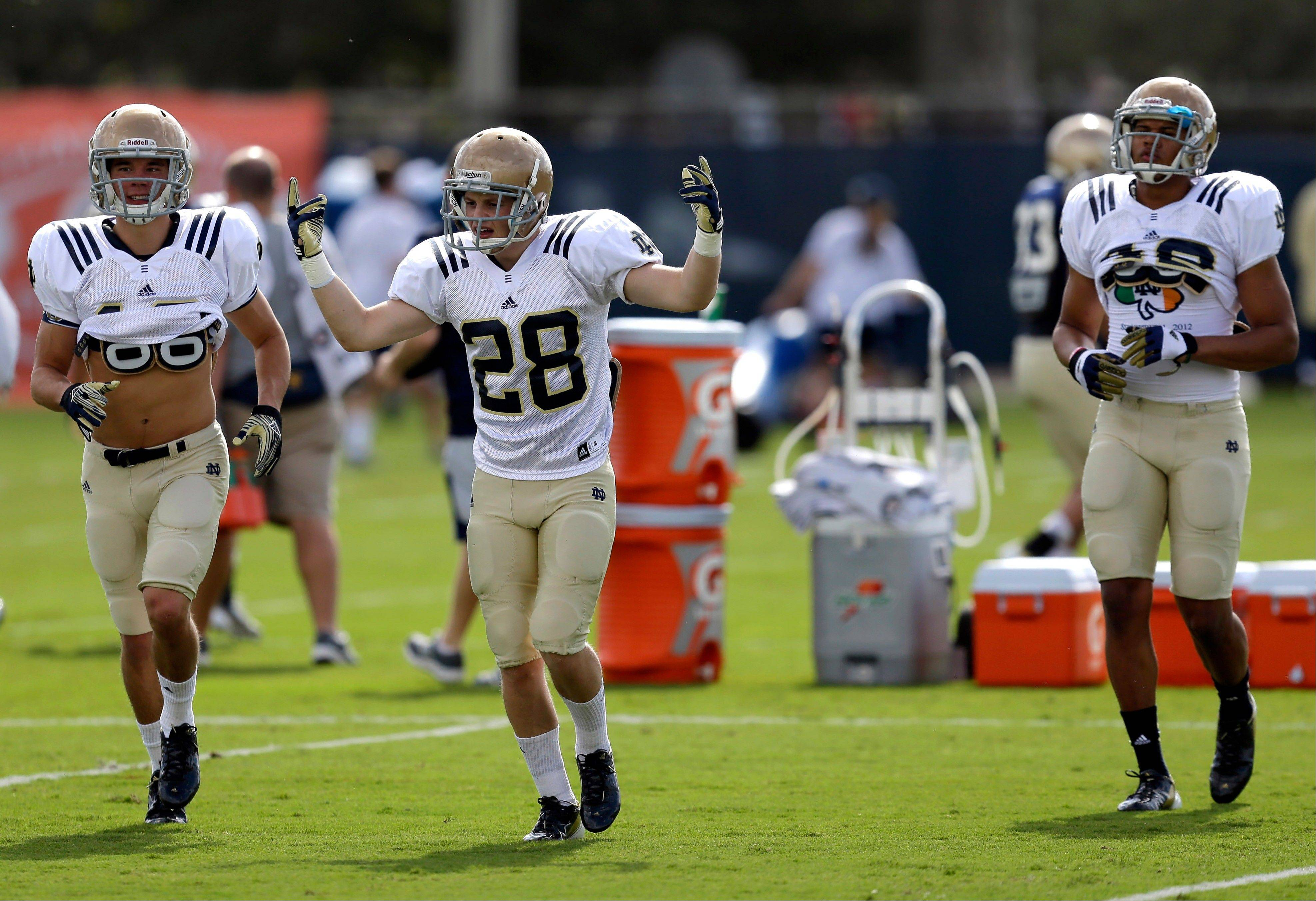 Notre Dame safety Austin Collinsworth (28) gestures as he and teammates prepare to run more drills Thursday during practice at the Miami Dolphins' training facility in Davie, Fla. Notre Dame is scheduled to play Alabama on Mondayin the BCS national championship.